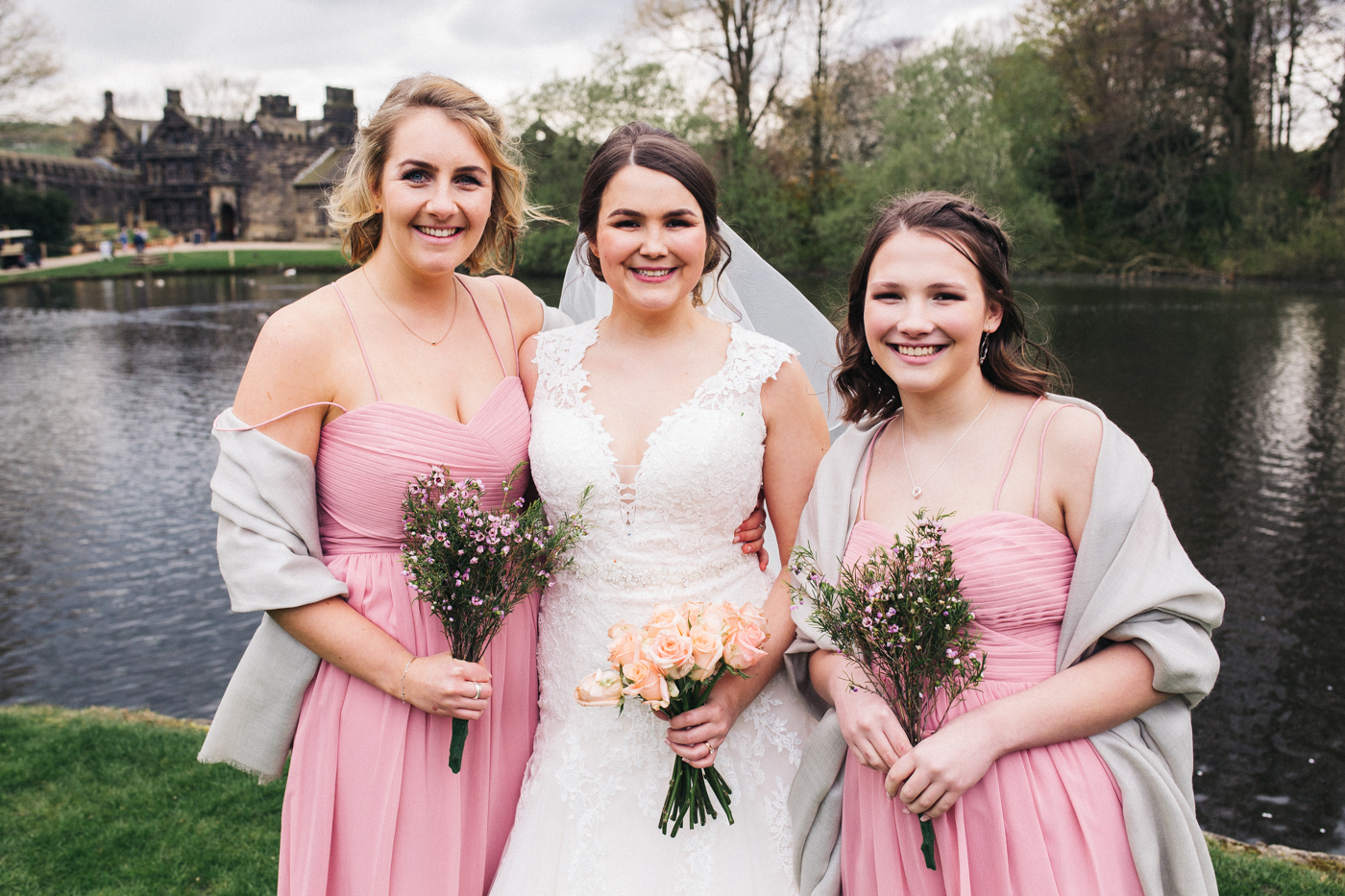 the bride and two bridesmaids. spring barn wedding at east riddlesden hall keighley west yorkshire wedding photographer