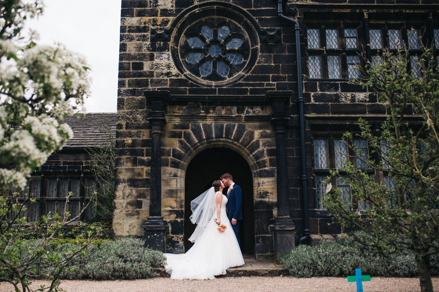 the bride and groom stand together at the main hall. spring barn wedding at east riddlesden hall keighley west yorkshire wedding photographer