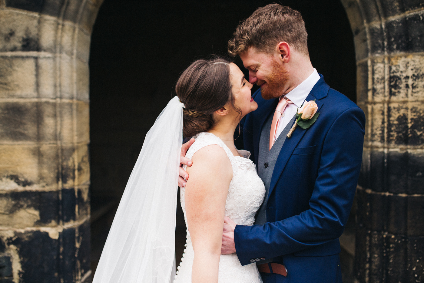 a closer shot of the bride and groom hugging. spring barn wedding at east riddlesden hall keighley west yorkshire wedding photographer