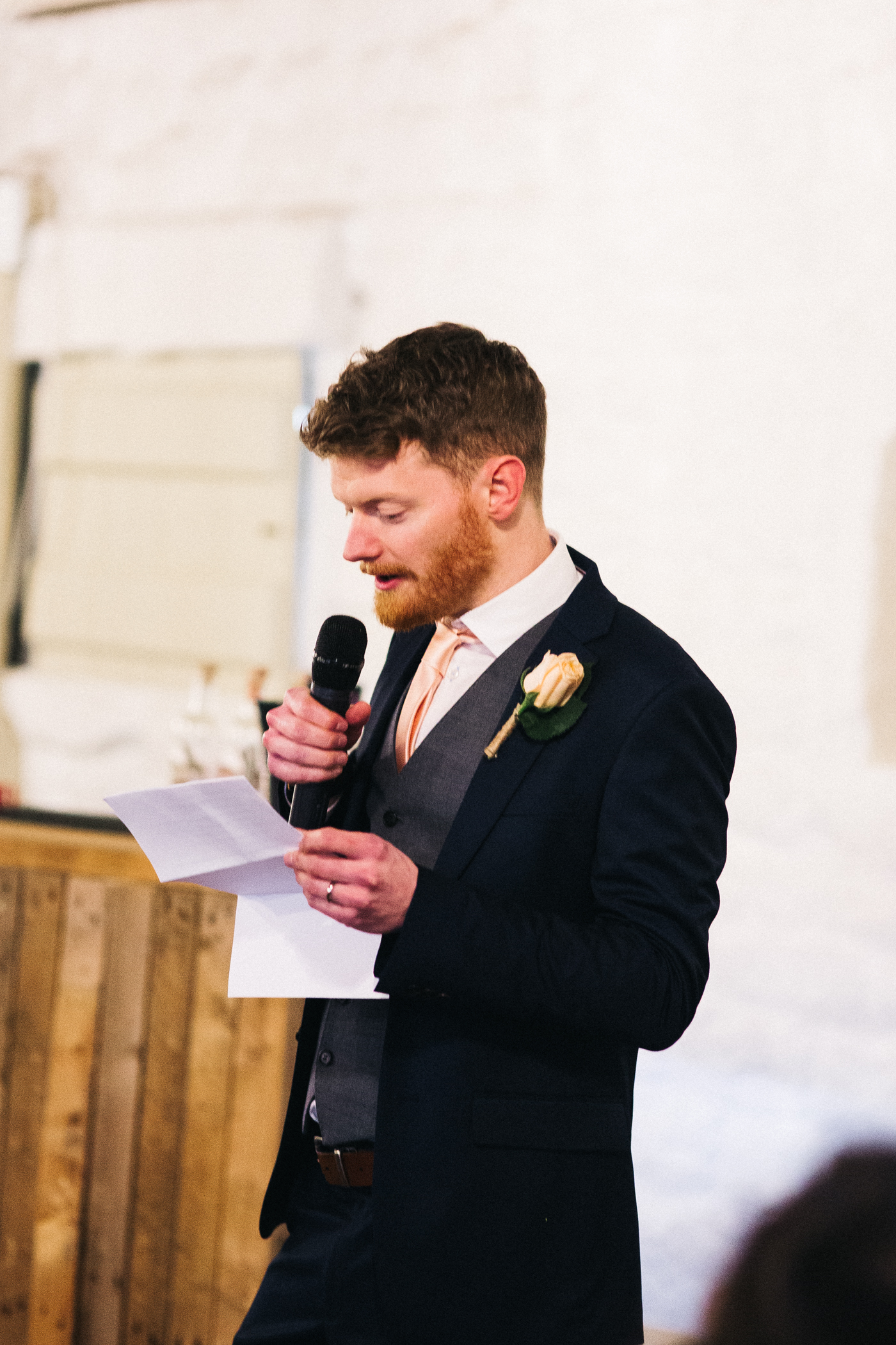 the speeches at the wedding. wide shot. spring barn wedding at east riddlesden hall keighley west yorkshire wedding photographer