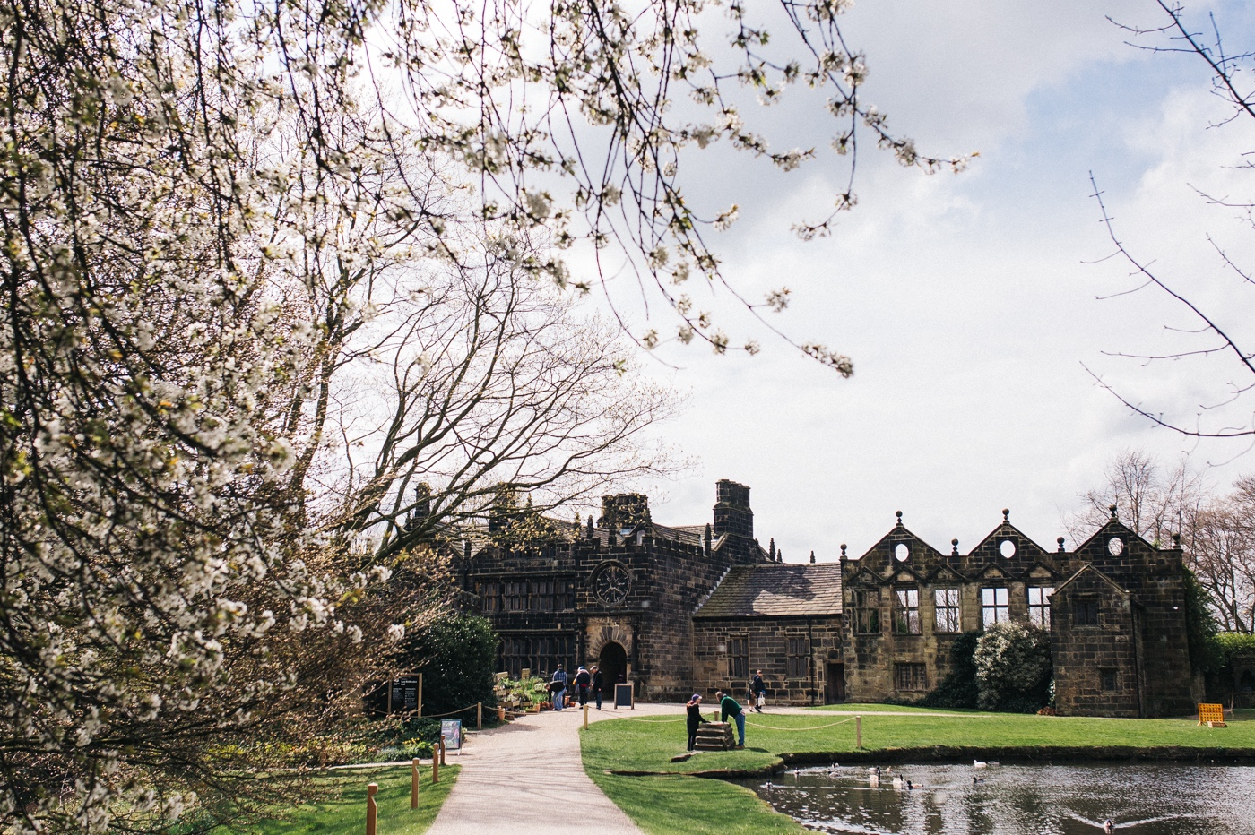 a wide shot of the venue. spring barn wedding at east riddlesden hall keighley west yorkshire wedding photographer