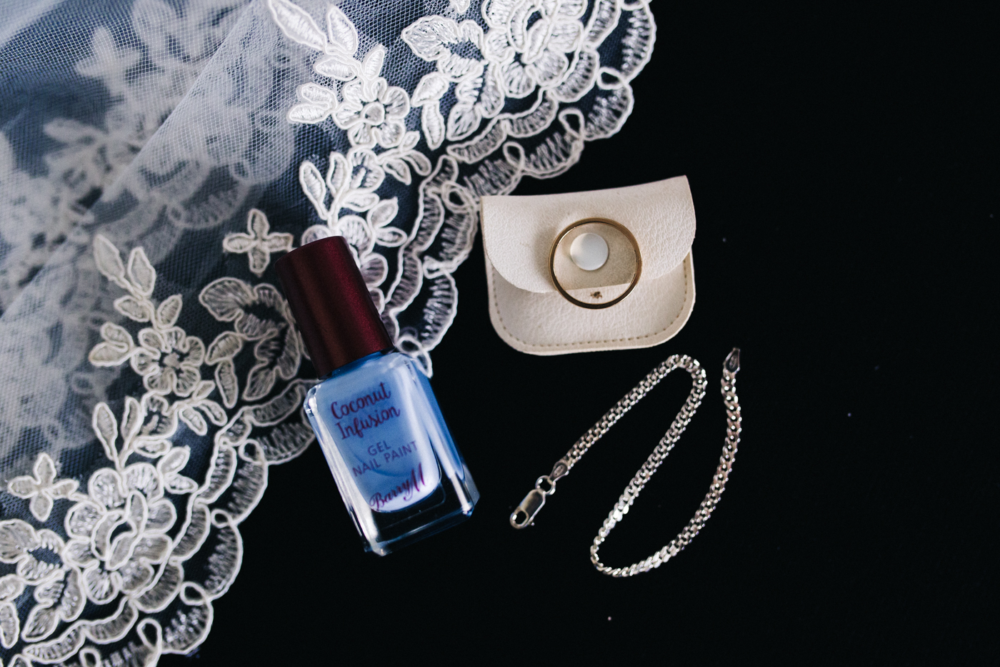 blue nail varnish, a wedding ring and a bracelet. relaxed teesside middlesbrough wedding photographer, wedding at home