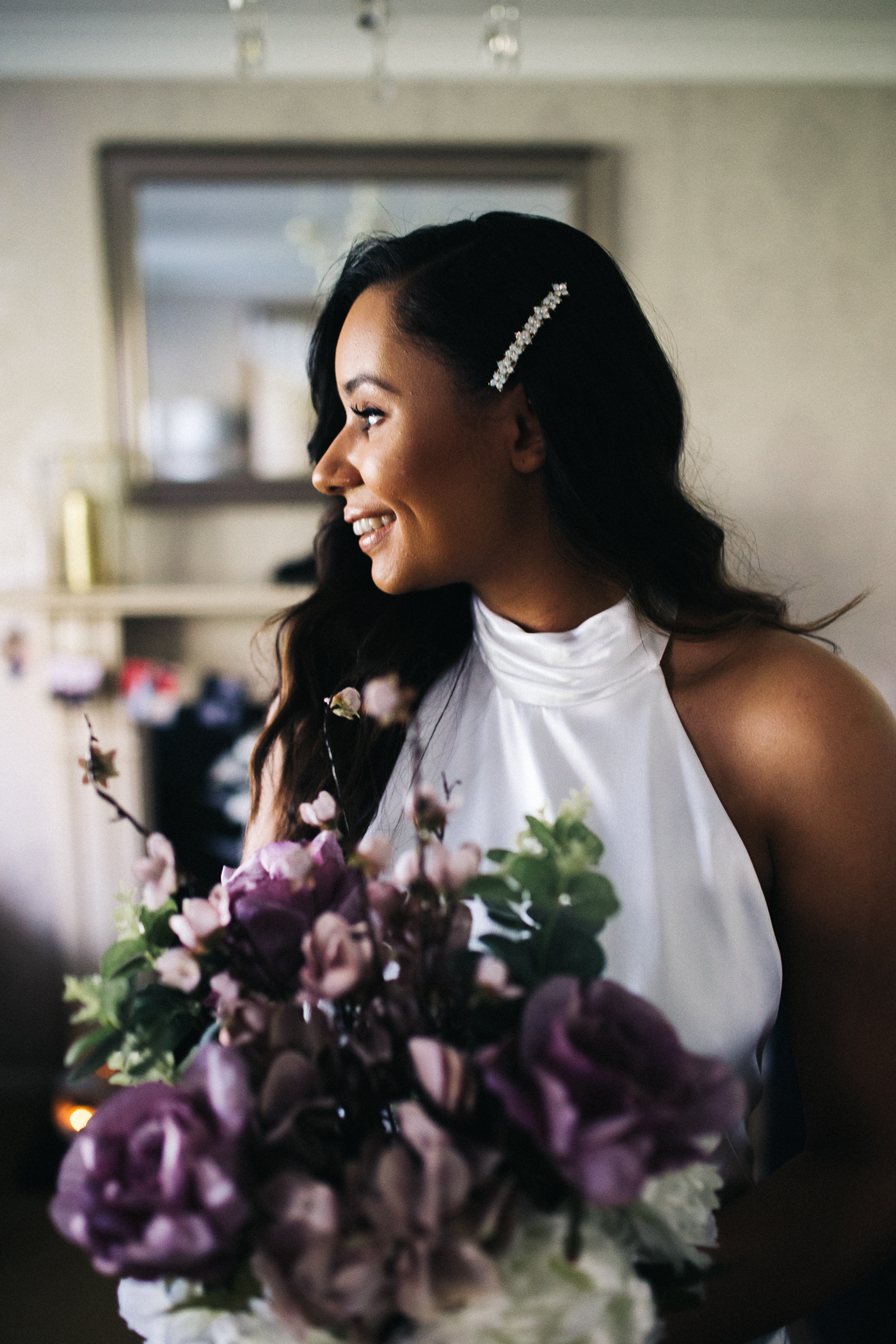 the bride stands, ready, with her bouquet. relaxed teesside middlesbrough wedding photographer, wedding at home