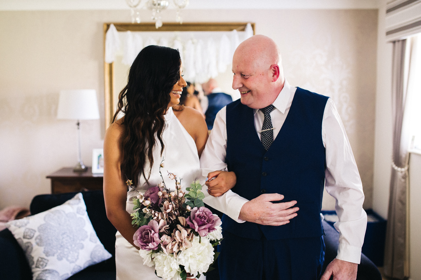 the bride and her dad look at each other smiling. relaxed teesside middlesbrough wedding photographer, wedding at home