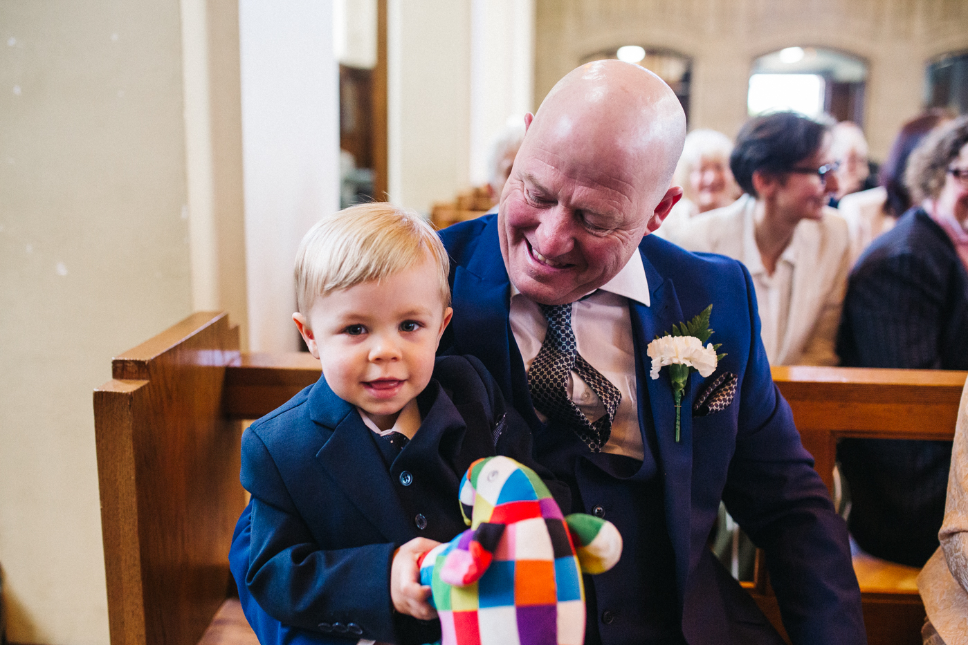 a little boy sits on his grandad's knee. relaxed teesside middlesbrough wedding photographer, wedding at home