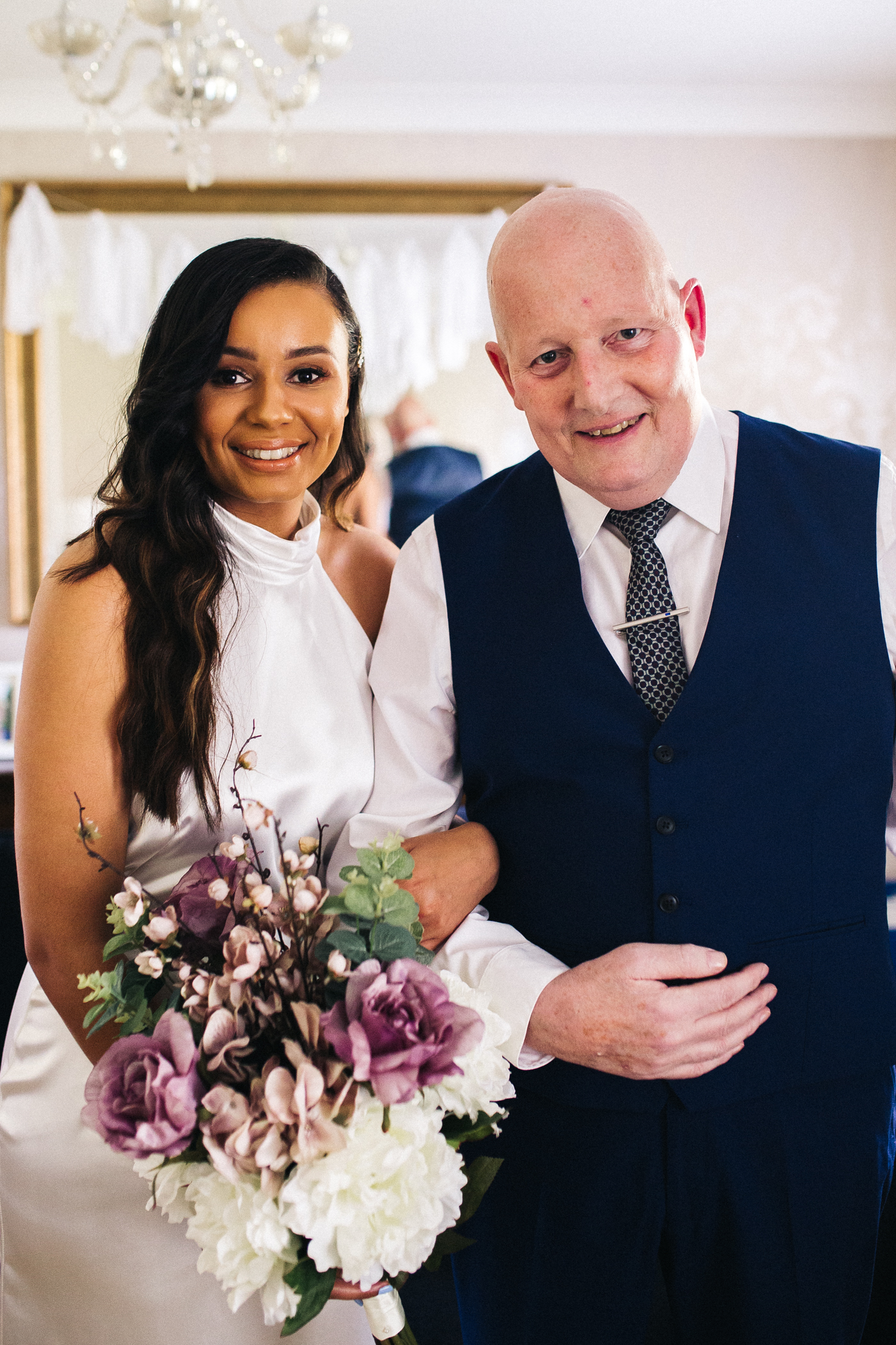 the bride and her dad look to camera. relaxed teesside middlesbrough wedding photographer, wedding at home