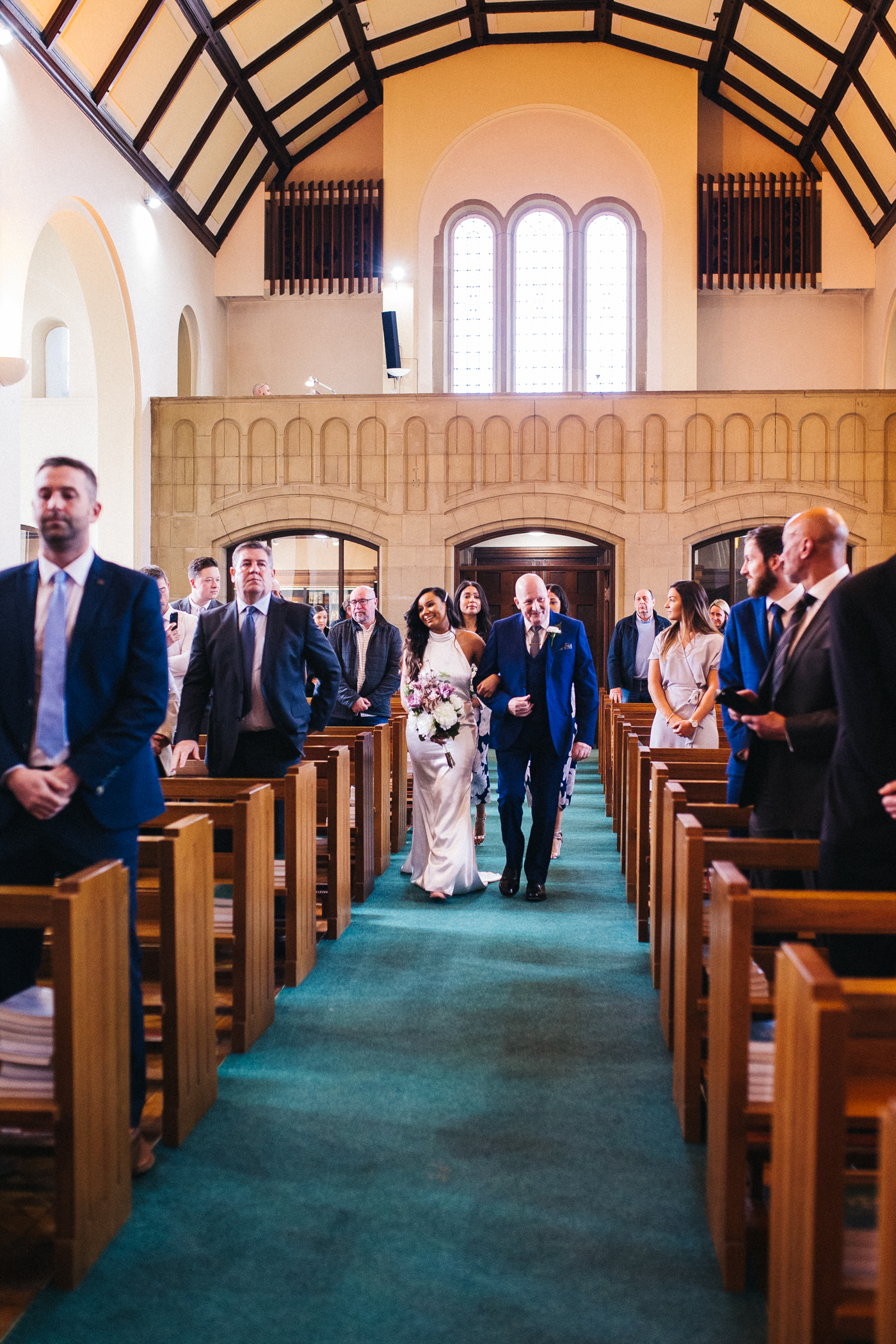 the bride and her dad walk down the aisle. relaxed teesside middlesbrough wedding photographer, wedding at home