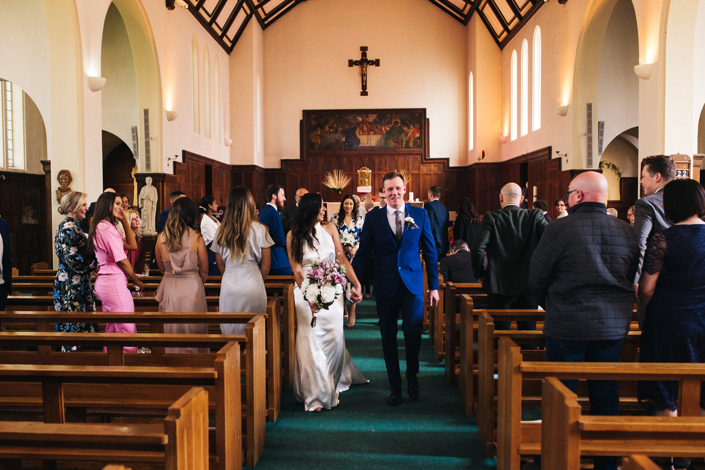 the bride and groom walk back up the aisle. relaxed teesside middlesbrough wedding photographer, wedding at home