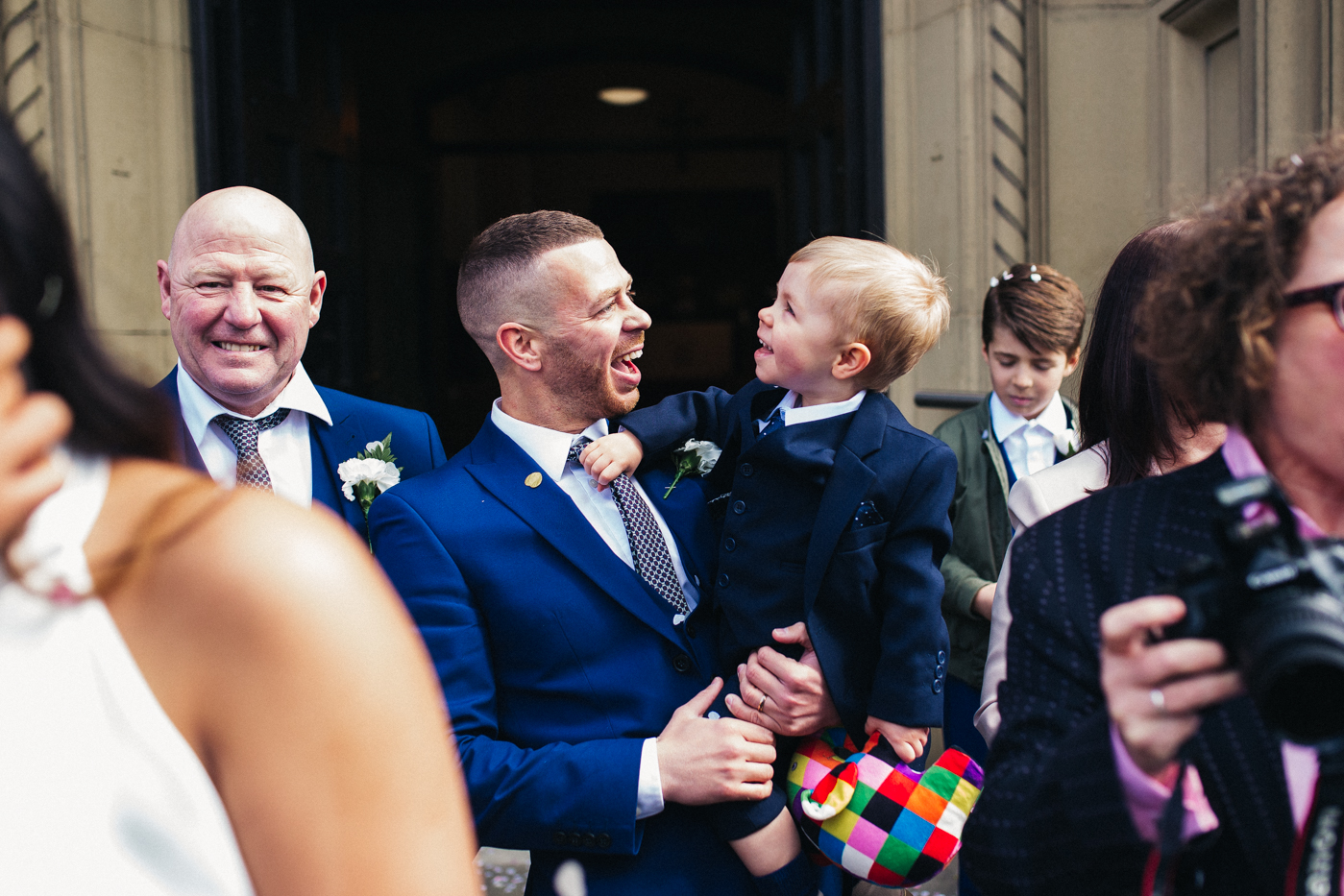 a little boy laughs at his dad during the confetti. relaxed teesside middlesbrough wedding photographer, wedding at home