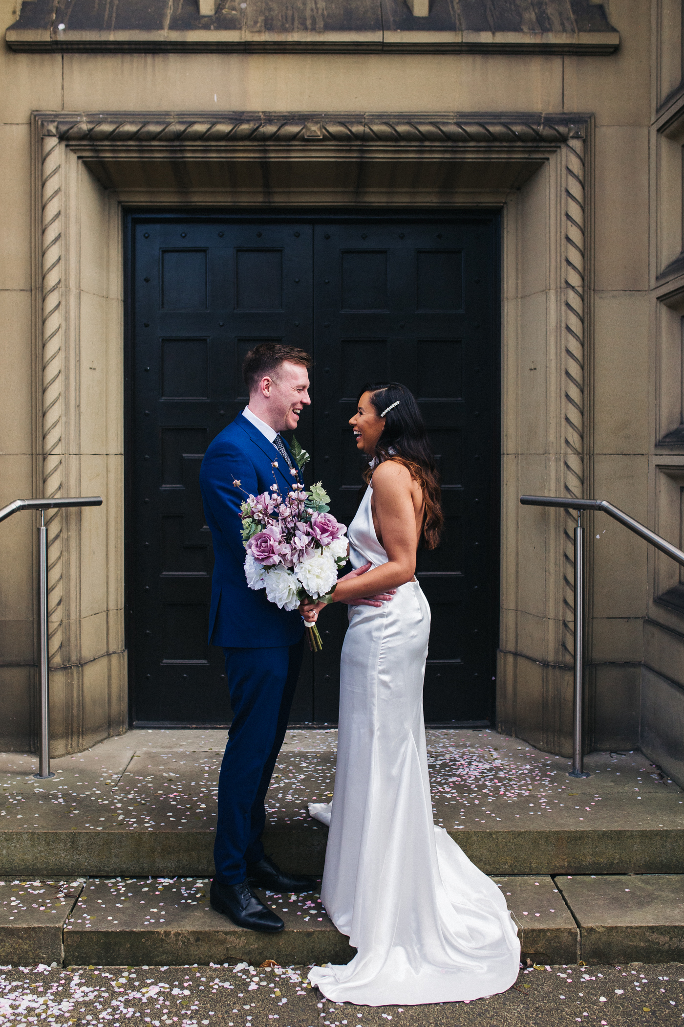 the bride and groom laugh together after the ceremony. relaxed teesside middlesbrough wedding photographer, wedding at home