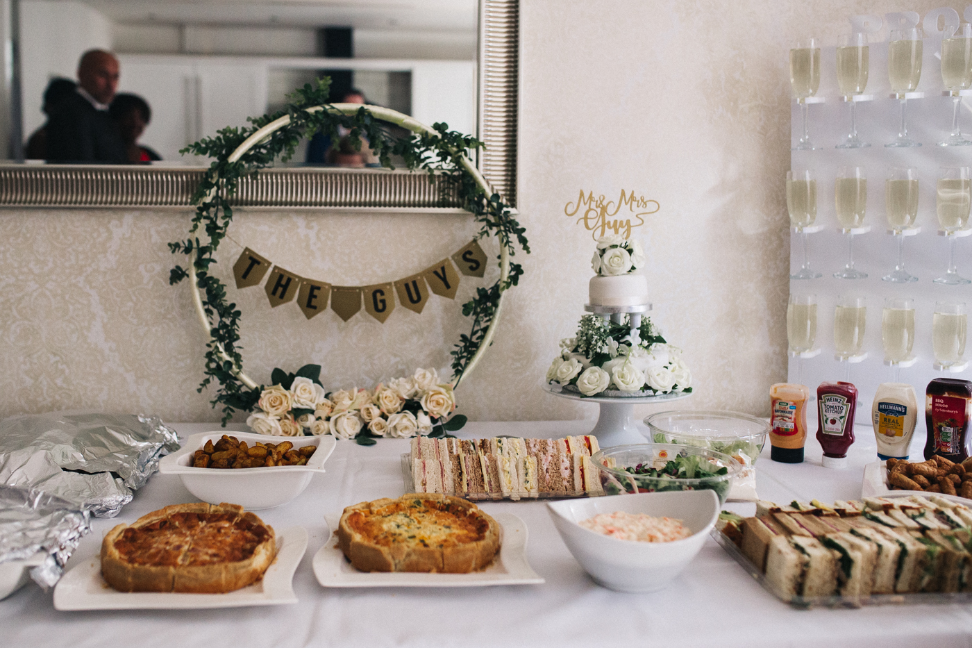 a buffet table with a wedding cake. relaxed teesside middlesbrough wedding photographer, wedding at home