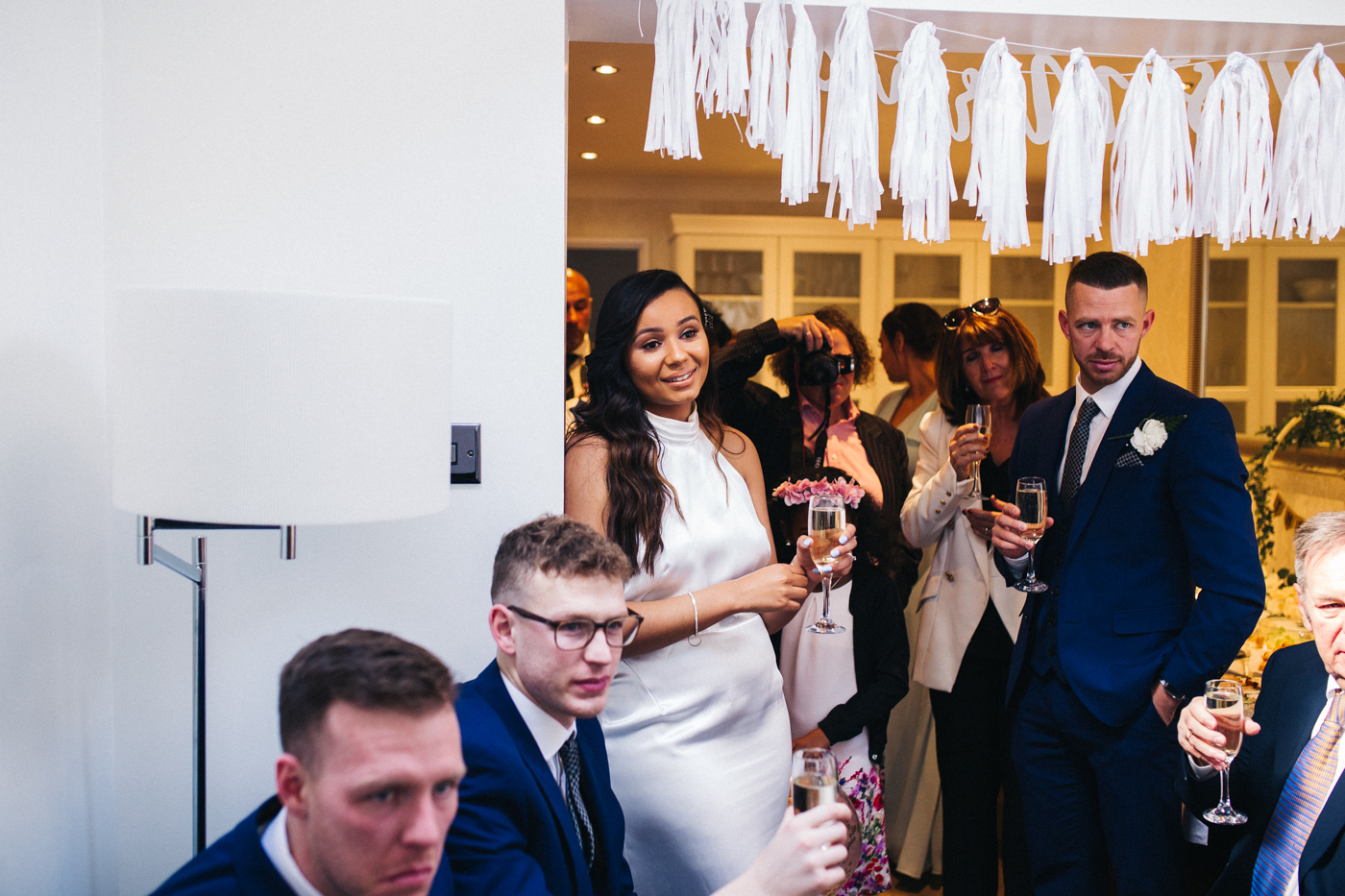 the bride and guests during the speeches. relaxed teesside middlesbrough wedding photographer, wedding at home