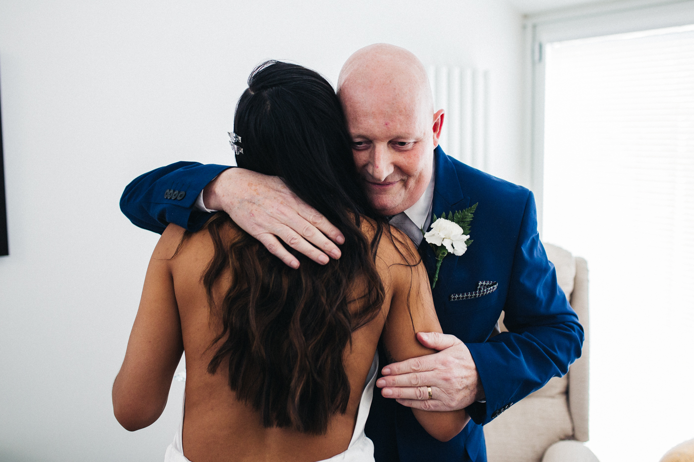 the bride and her dad hug during the speeches. relaxed teesside middlesbrough wedding photographer, wedding at home