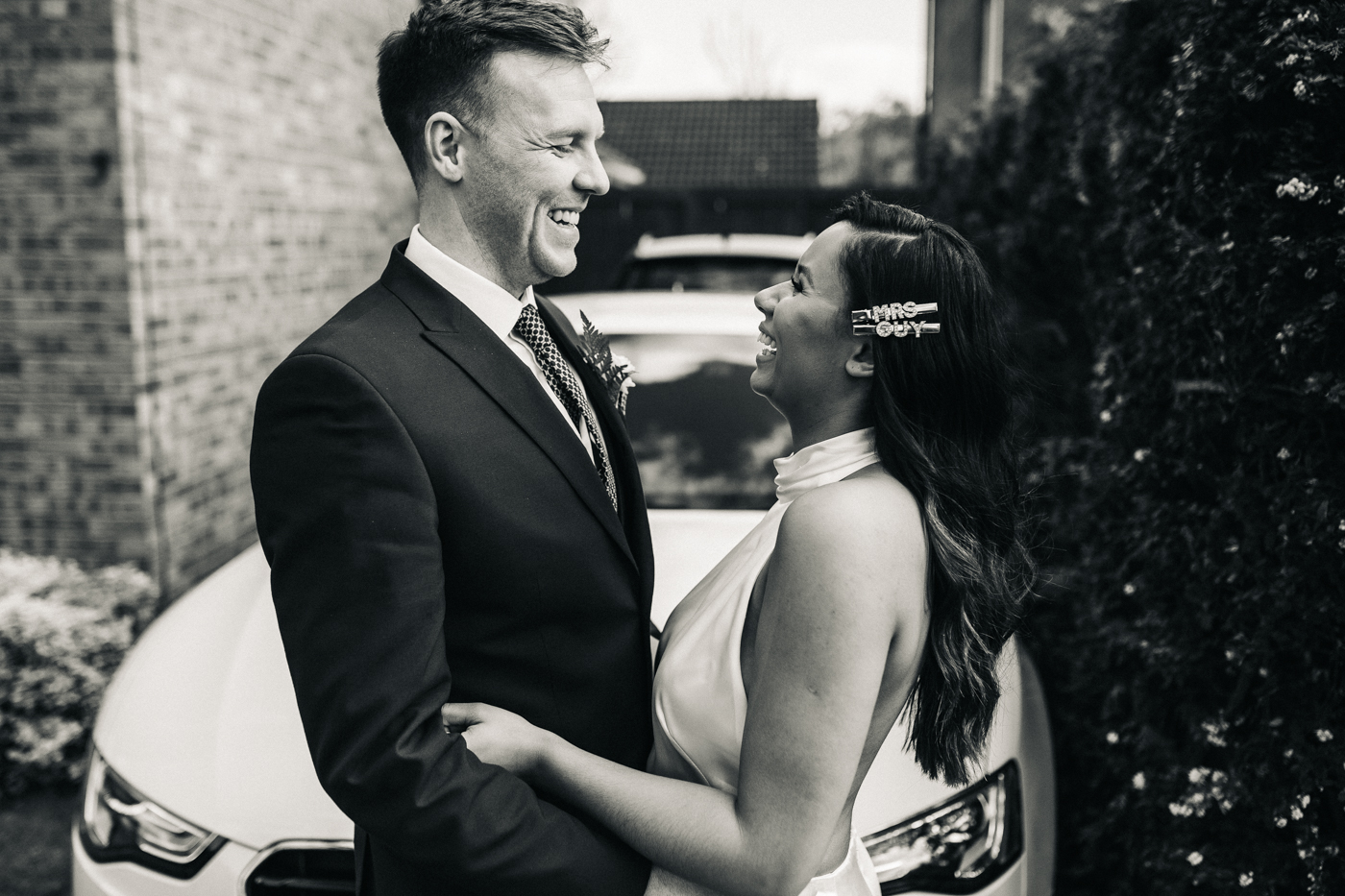 the bride and groom laugh at each other. relaxed teesside middlesbrough wedding photographer, wedding at home