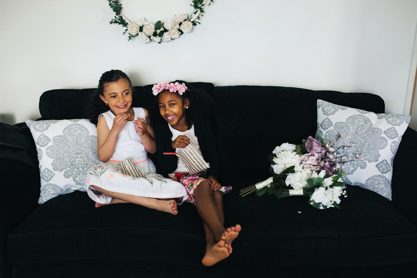 two girls sit together on a couch. relaxed teesside middlesbrough wedding photographer, wedding at home
