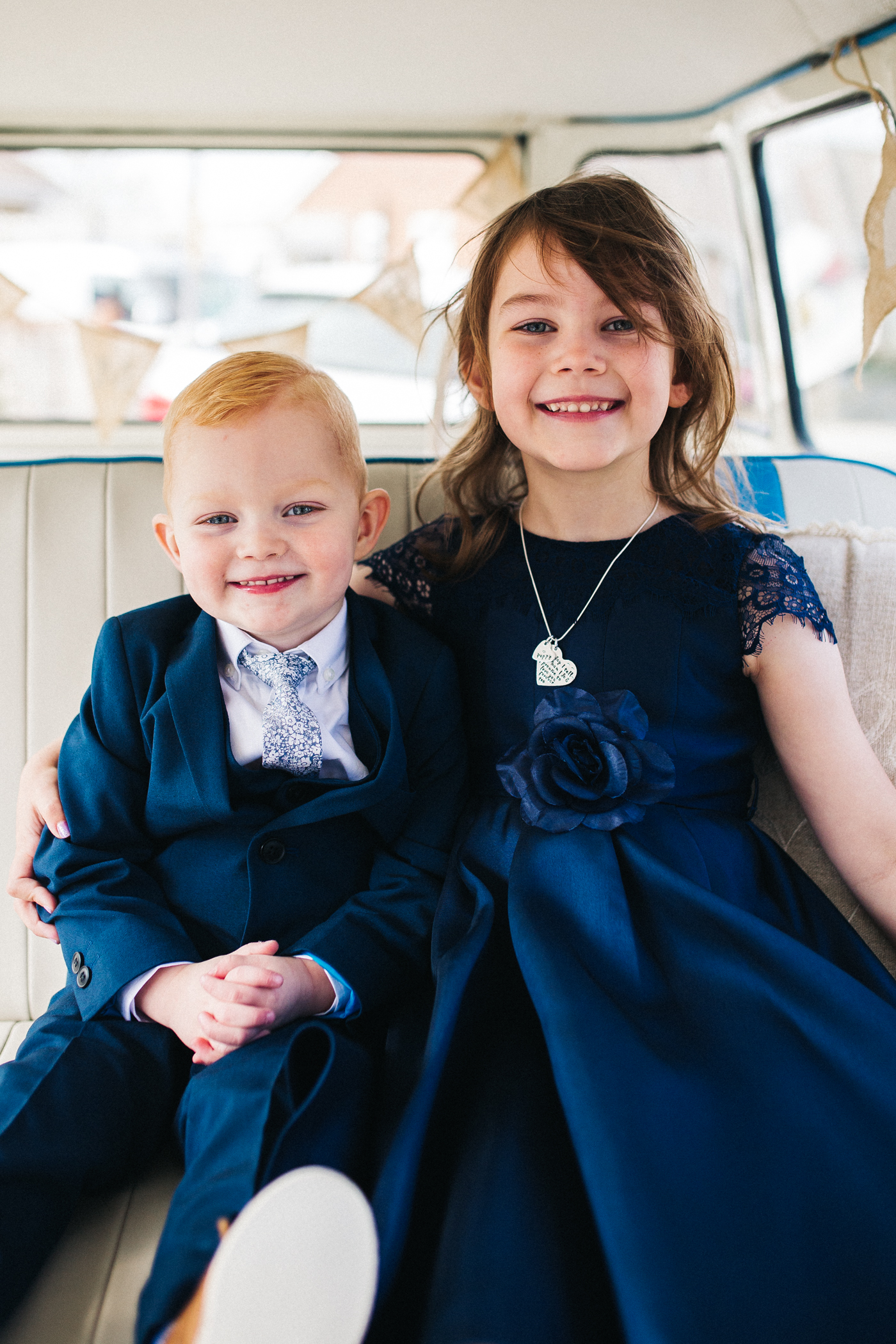 a young girl and boy smile at the camera sitting together. preston park museum wedding stockton teesside middlesbrough wedding photographer
