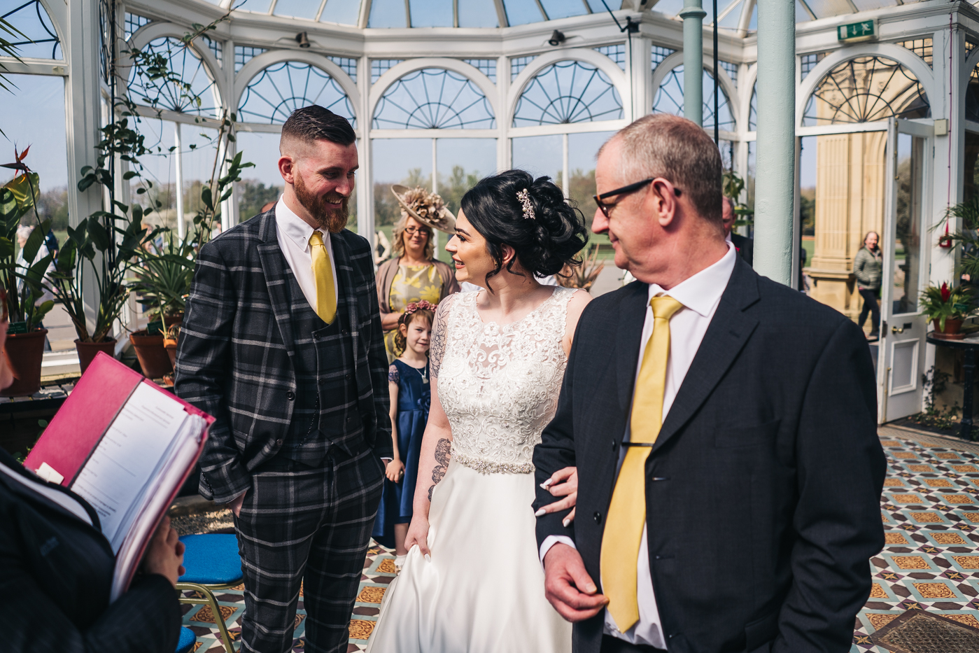 a bride and groom smile at each other during their wedding ceremony. preston park museum wedding stockton teesside middlesbrough wedding photographer