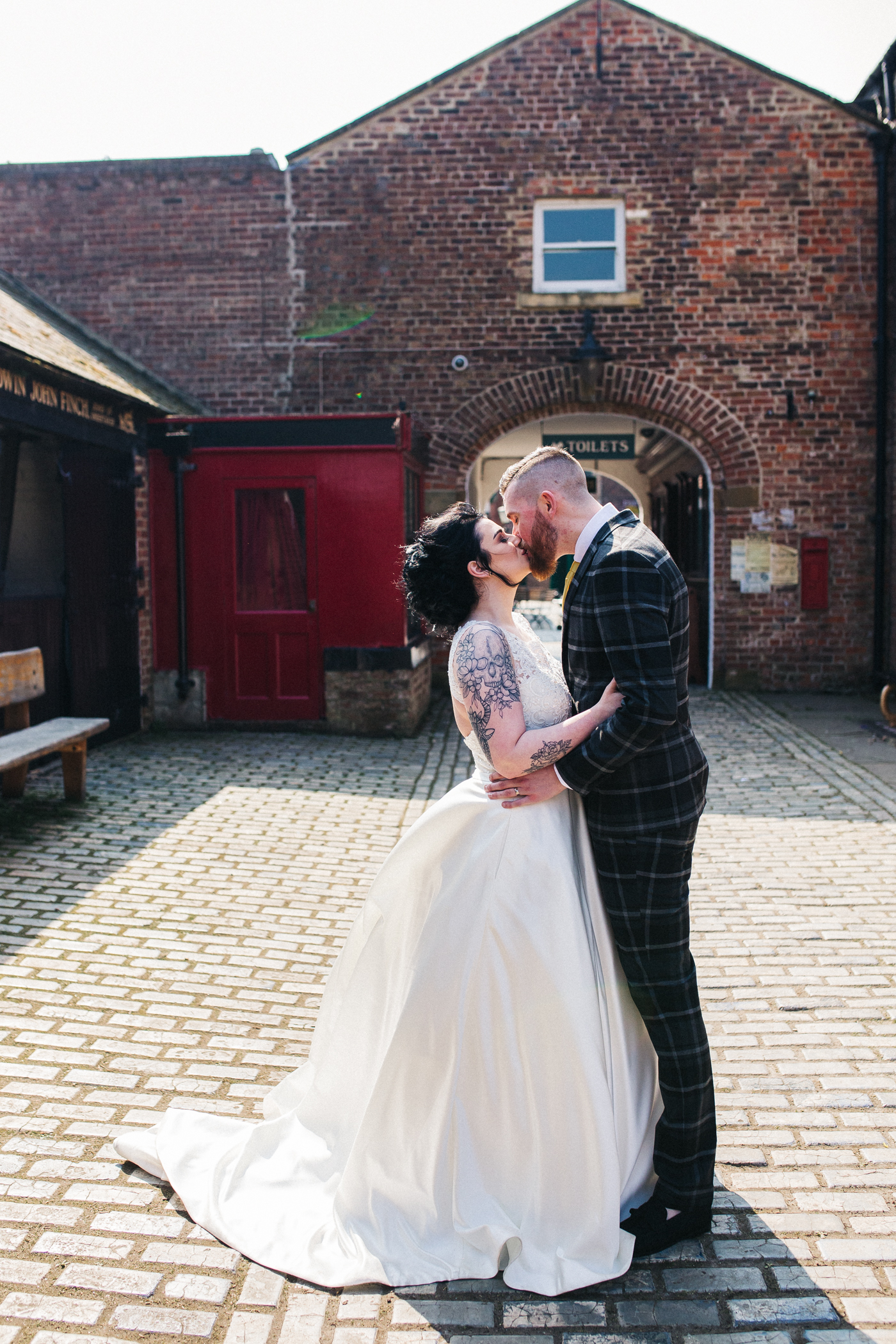 a bride and groom kiss in a victorian street. preston park museum wedding stockton teesside middlesbrough wedding photographer