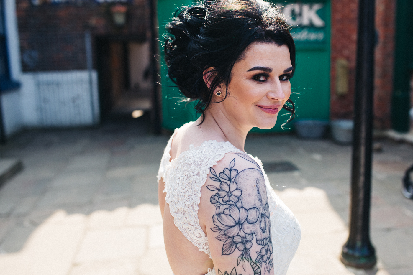 the bride looks over her shoulder and smiles. preston park museum wedding stockton teesside middlesbrough wedding photographer