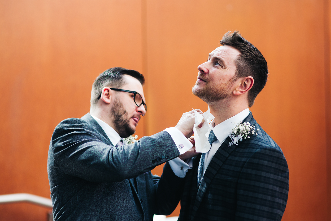 a groom has his tie done up before the ceremony. wedding at the baltic newcastle gateshead north east photographer
