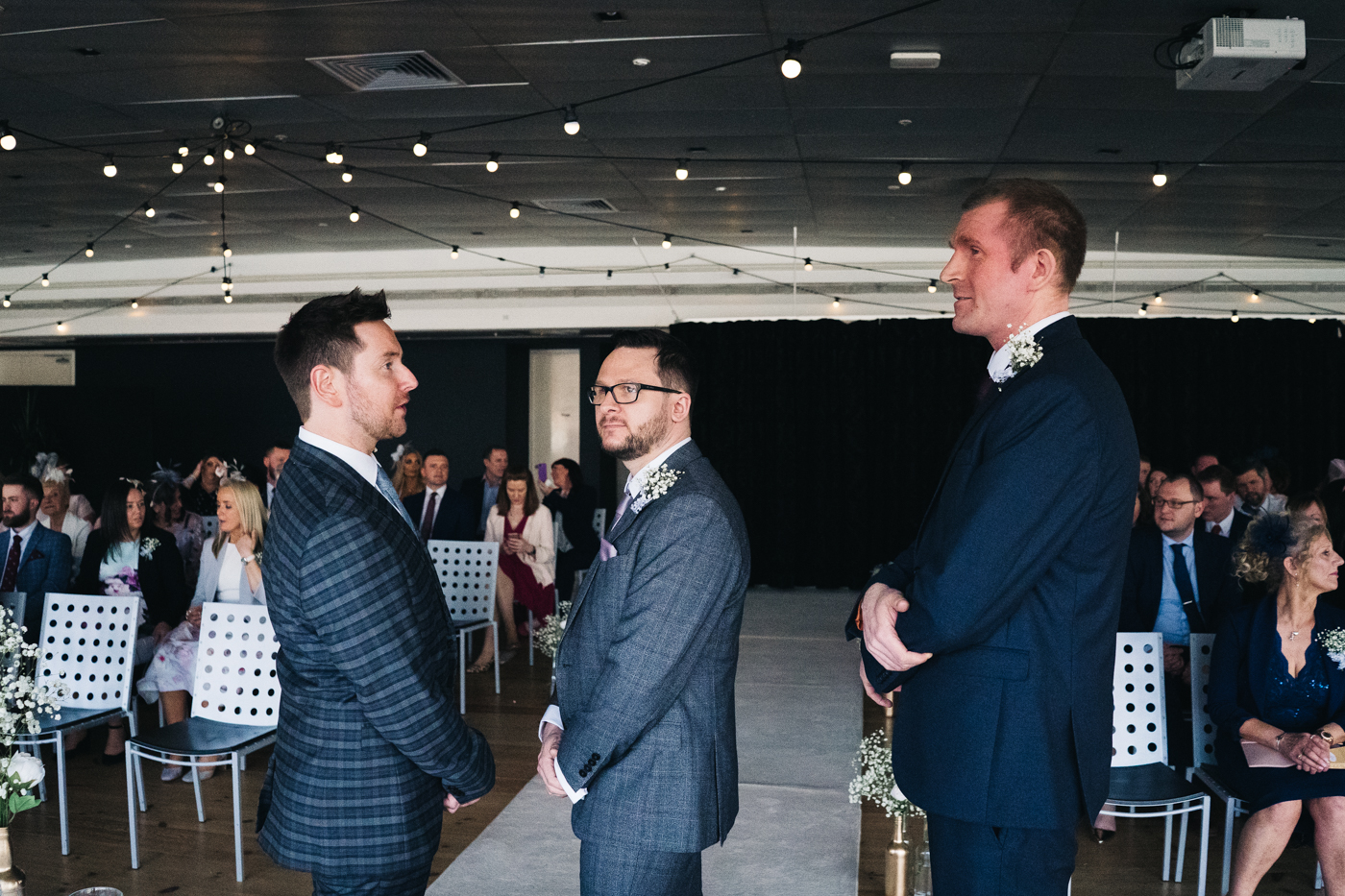 the groom and groomsmen stand at the front of the ceremony. wedding at the baltic newcastle gateshead north east photographer