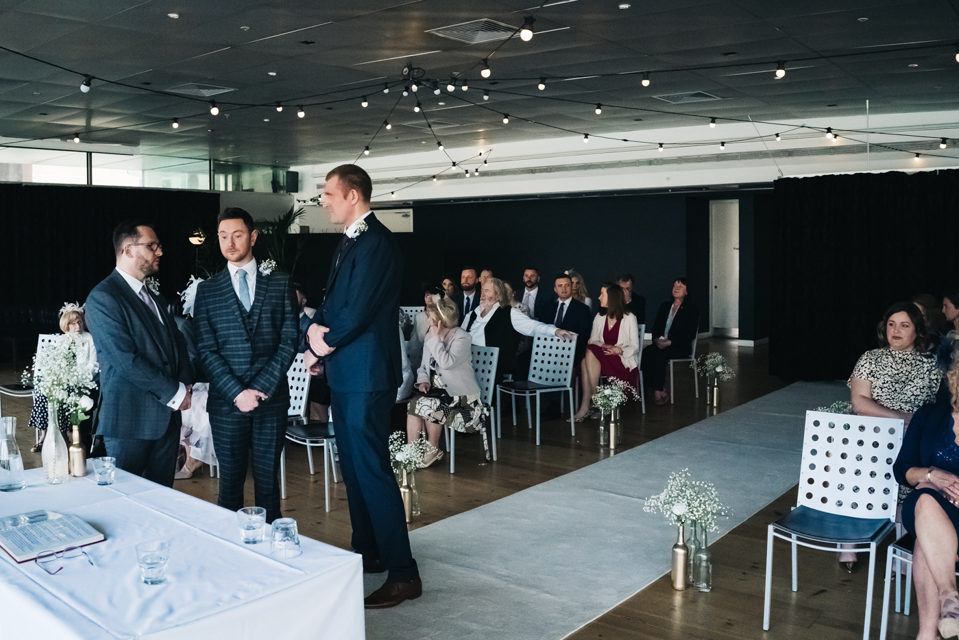 the groom and groomsmen stand waiting at the bottom of the aisle. wedding at the baltic newcastle gateshead north east photographer