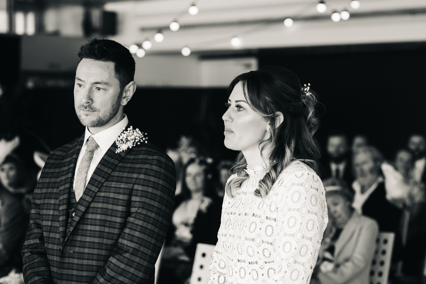 a black and white shot of the couple during their ceremony. wedding at the baltic newcastle gateshead north east photographer