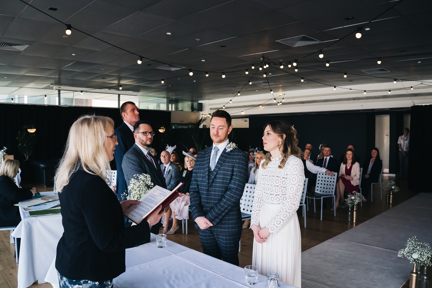 the bride and groom stand at the bottom of the aisle together. wedding at the baltic newcastle gateshead north east photographer