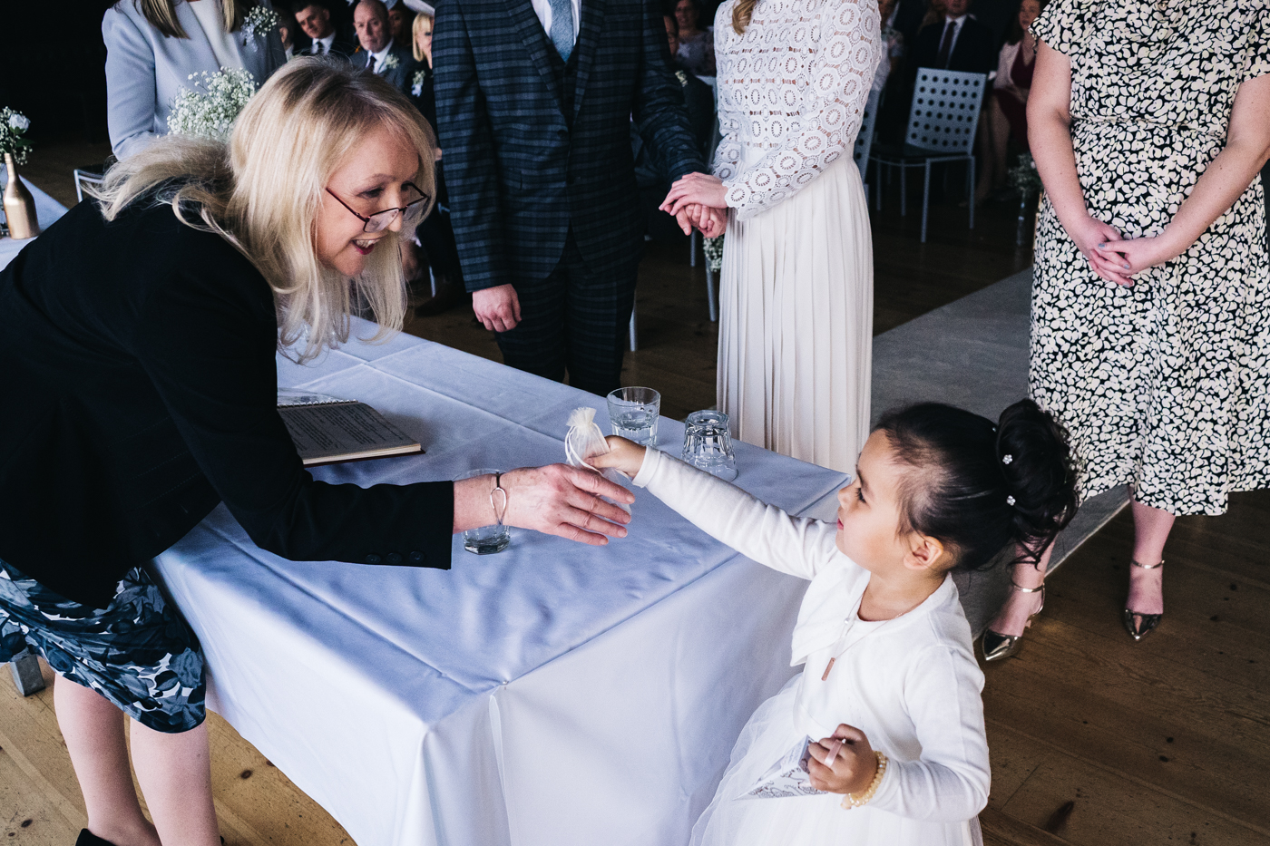 a flowergirl hands the rings to the registrar during the ceremony. wedding at the baltic newcastle gateshead north east photographer