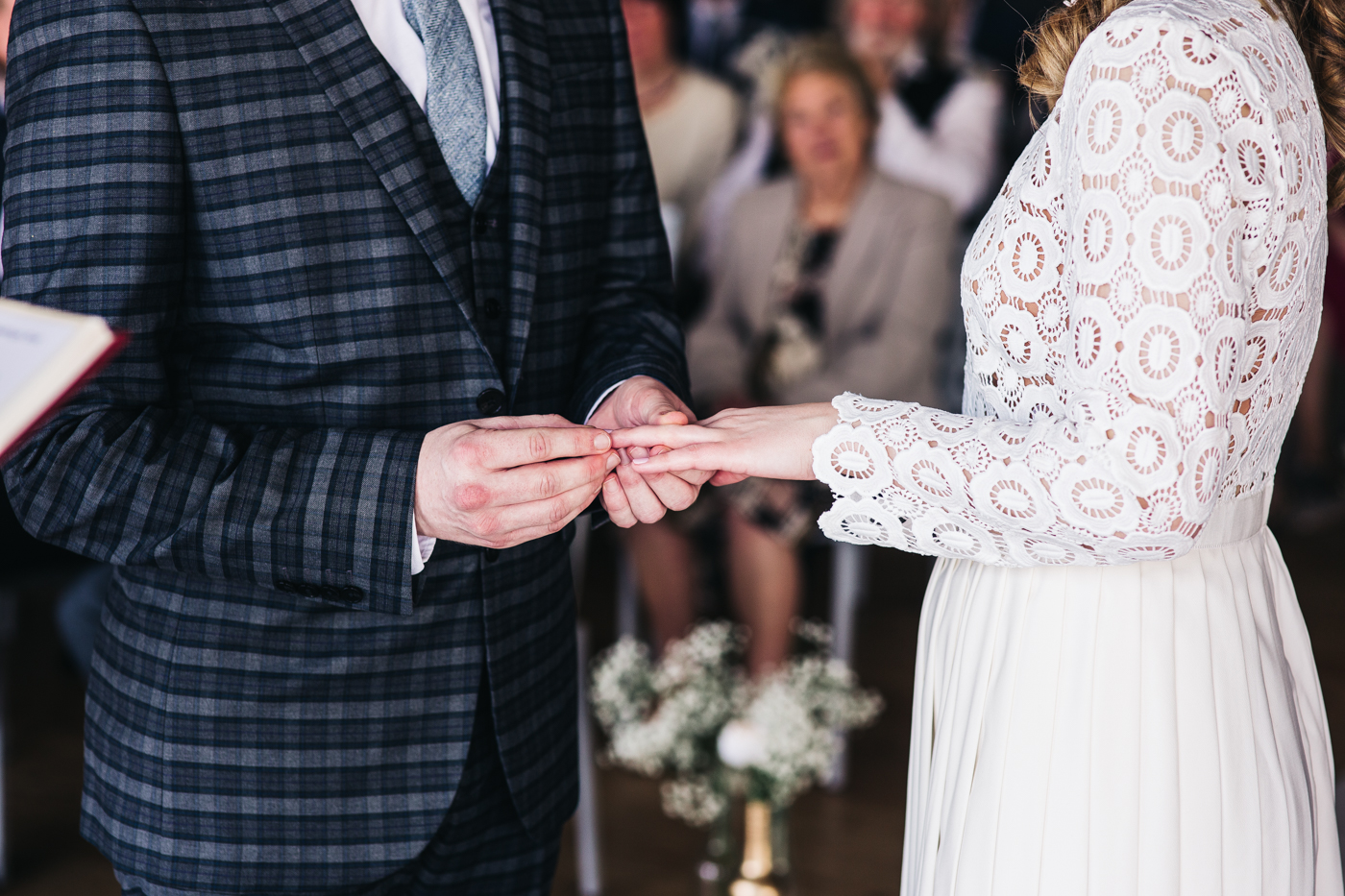 a close up shot of the groom putting the bride's ring on her hand. wedding at the baltic newcastle gateshead north east photographer