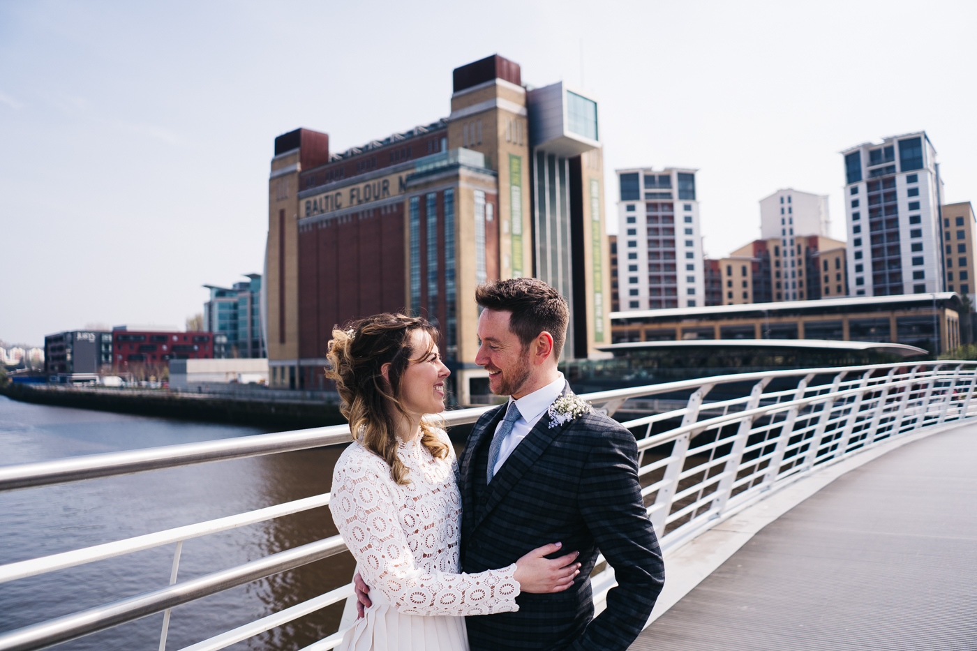 the couple stand together with the baltic in the background. wedding at the baltic newcastle gateshead north east photographer