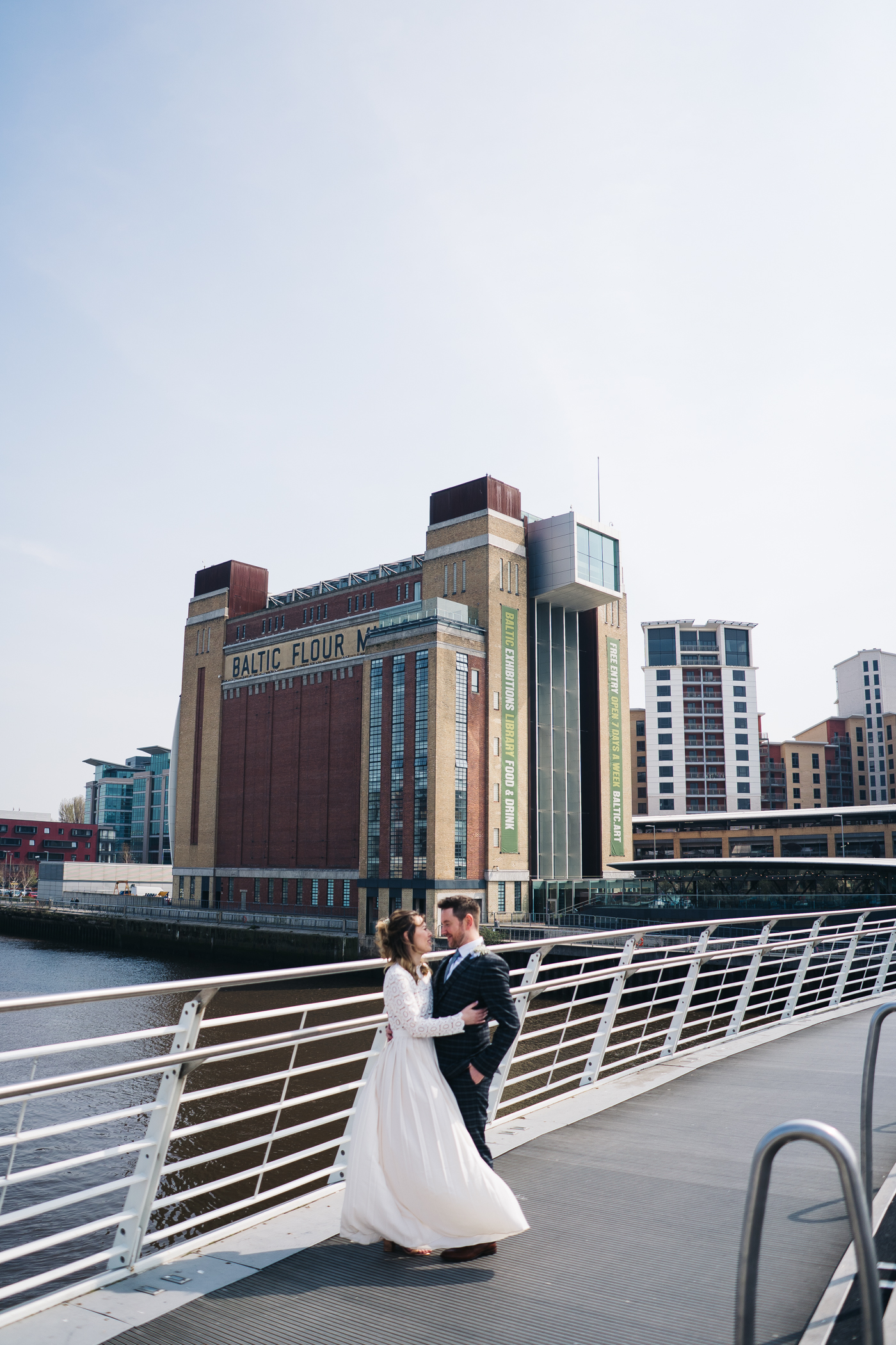 a shot of the couple standing together with the baltic in the background. wedding at the baltic newcastle gateshead north east photographer