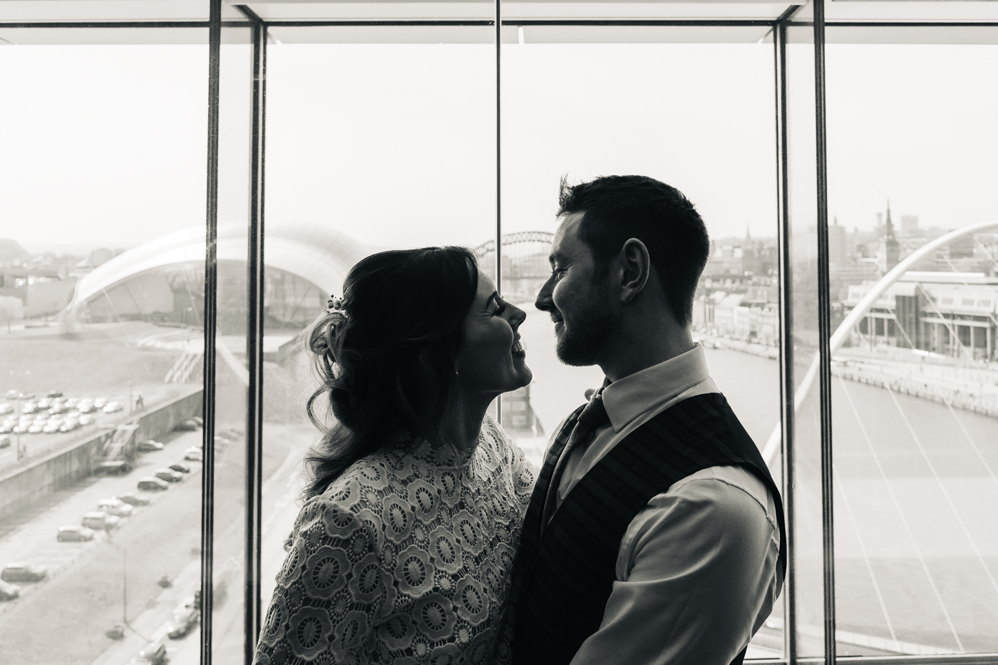 a black and white closer shot of the bride and groom against the skyline. wedding at the baltic newcastle gateshead north east photographer