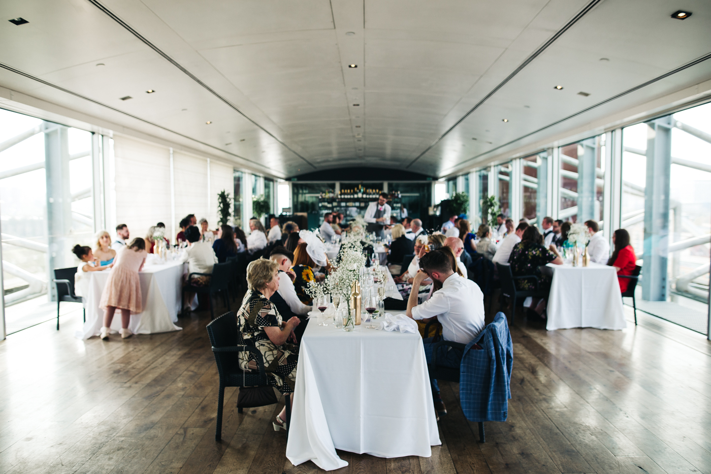 a wide shot of all guests seated for the meal. wedding at the baltic newcastle gateshead north east photographer