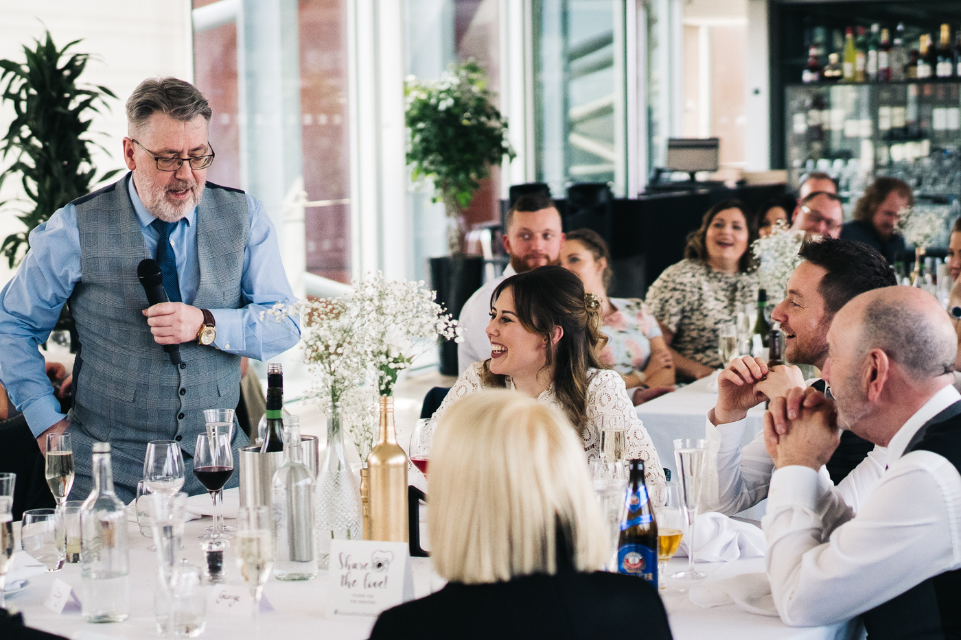 the bride smiles at her dad as he does his speech. wedding at the baltic newcastle gateshead north east photographer
