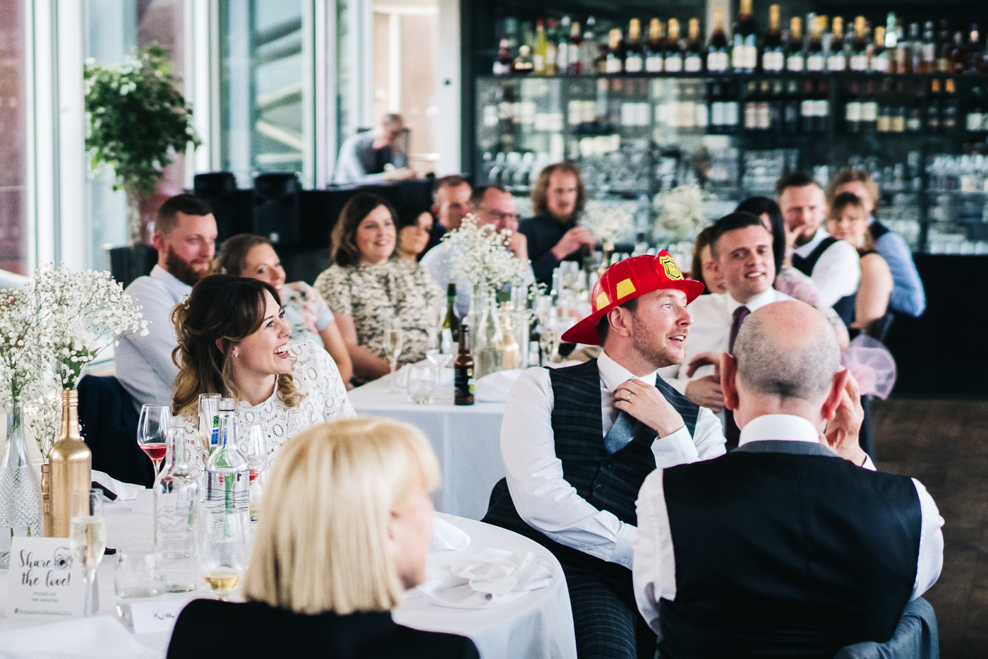 the bride and groom laugh during the speeches. wedding at the baltic newcastle gateshead north east photographer