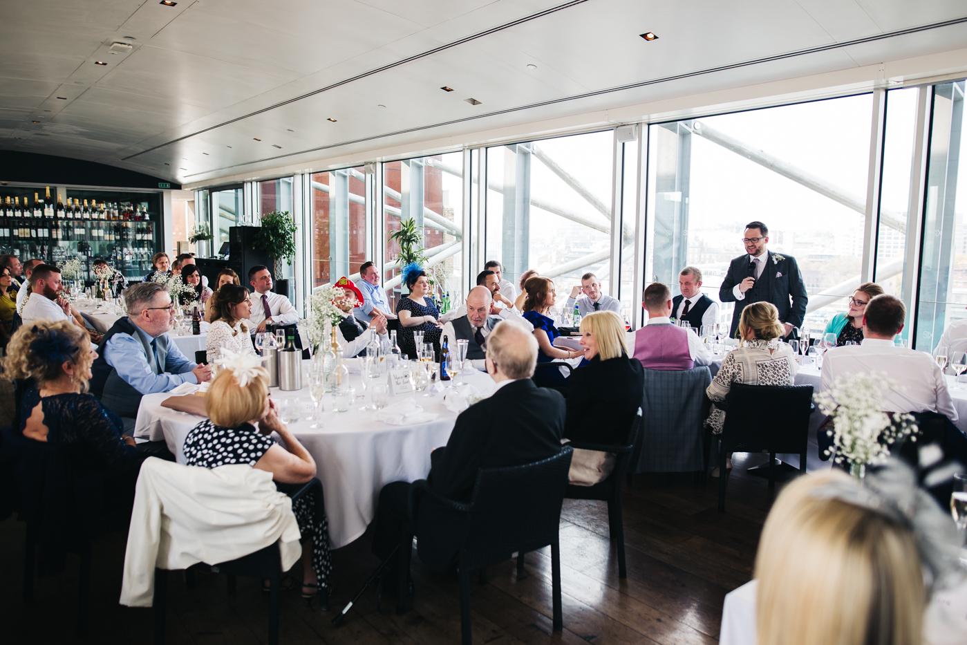 a wide shot of the best man doing his speech. wedding at the baltic newcastle gateshead north east photographer