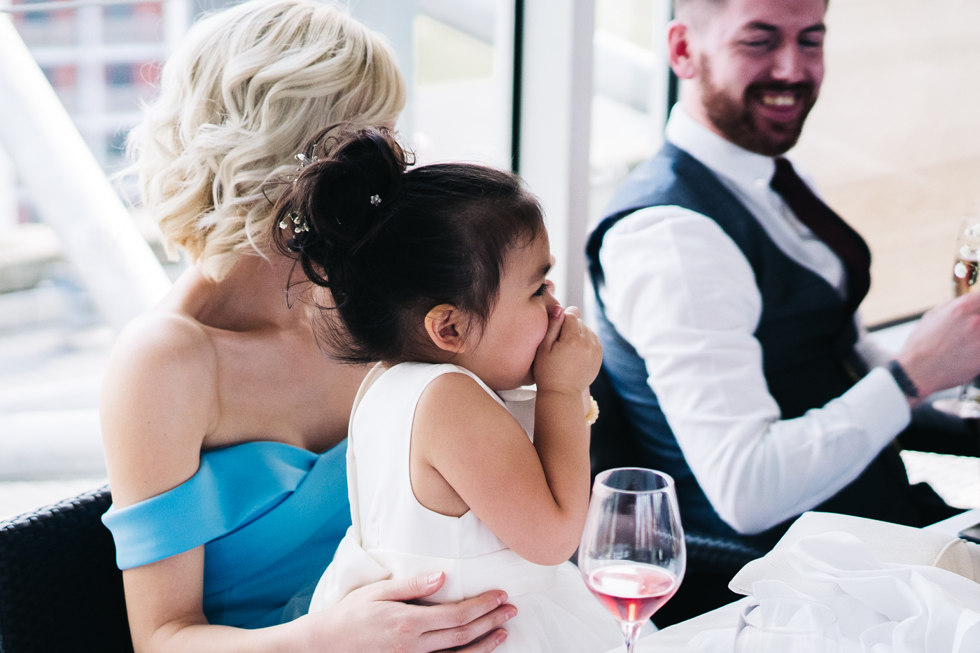 a flower girl giggles during the speeches. wedding at the baltic newcastle gateshead north east photographer