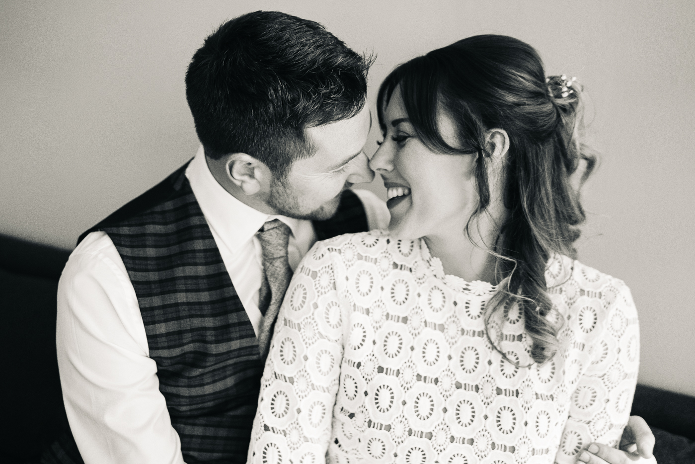 a black and white shot of the couple sitting closely with heads together. wedding at the baltic newcastle gateshead north east photographer