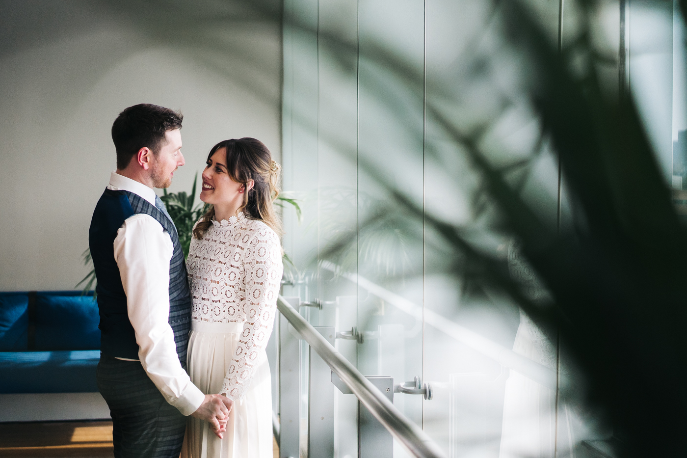 the couple stand next to a large indoor plant holding hands. wedding at the baltic newcastle gateshead north east photographer