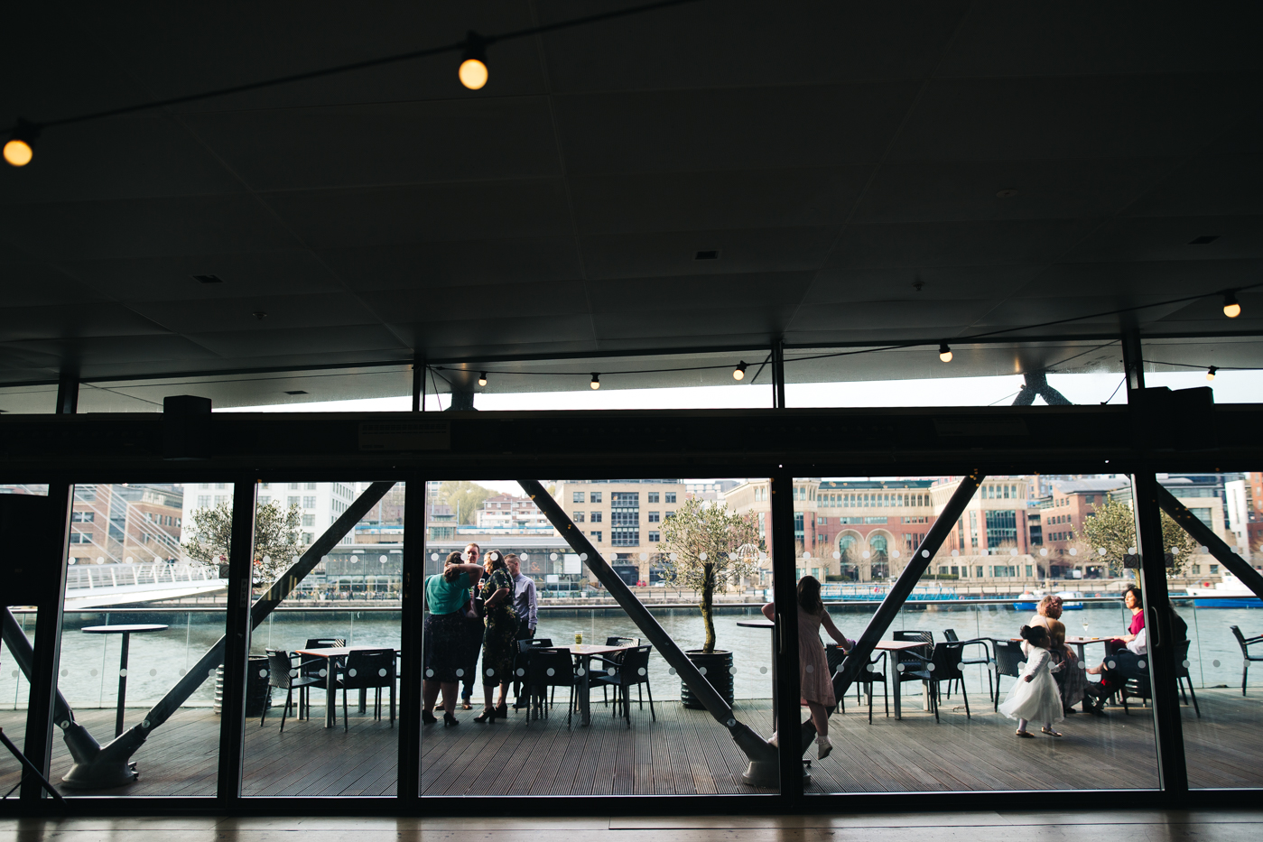 a wide shot through an industrial window looking out to the river. wedding at the baltic newcastle gateshead north east photographer