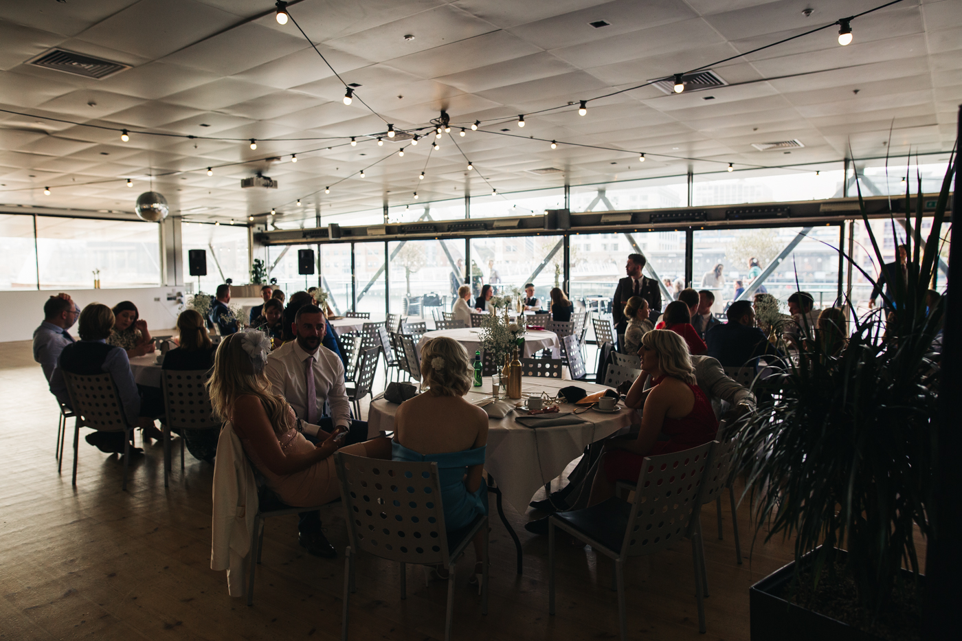 a wide shot of guests seated at the evening reception. wedding at the baltic newcastle gateshead north east photographer