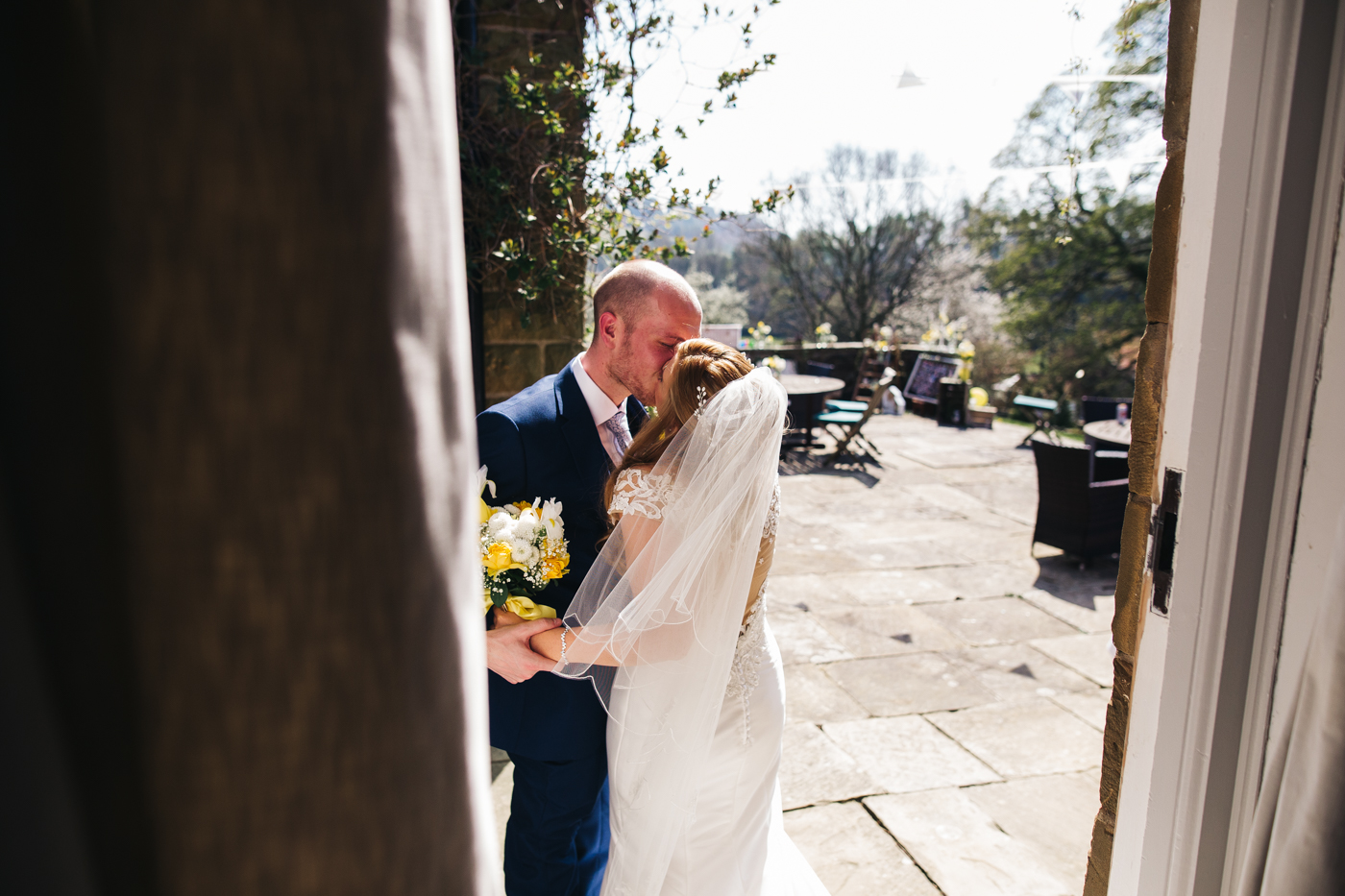 a bride and groom kiss outside immediately after their ceremony. wedding at laskill house north yorkshire helmsley wedding photographer north east teesside