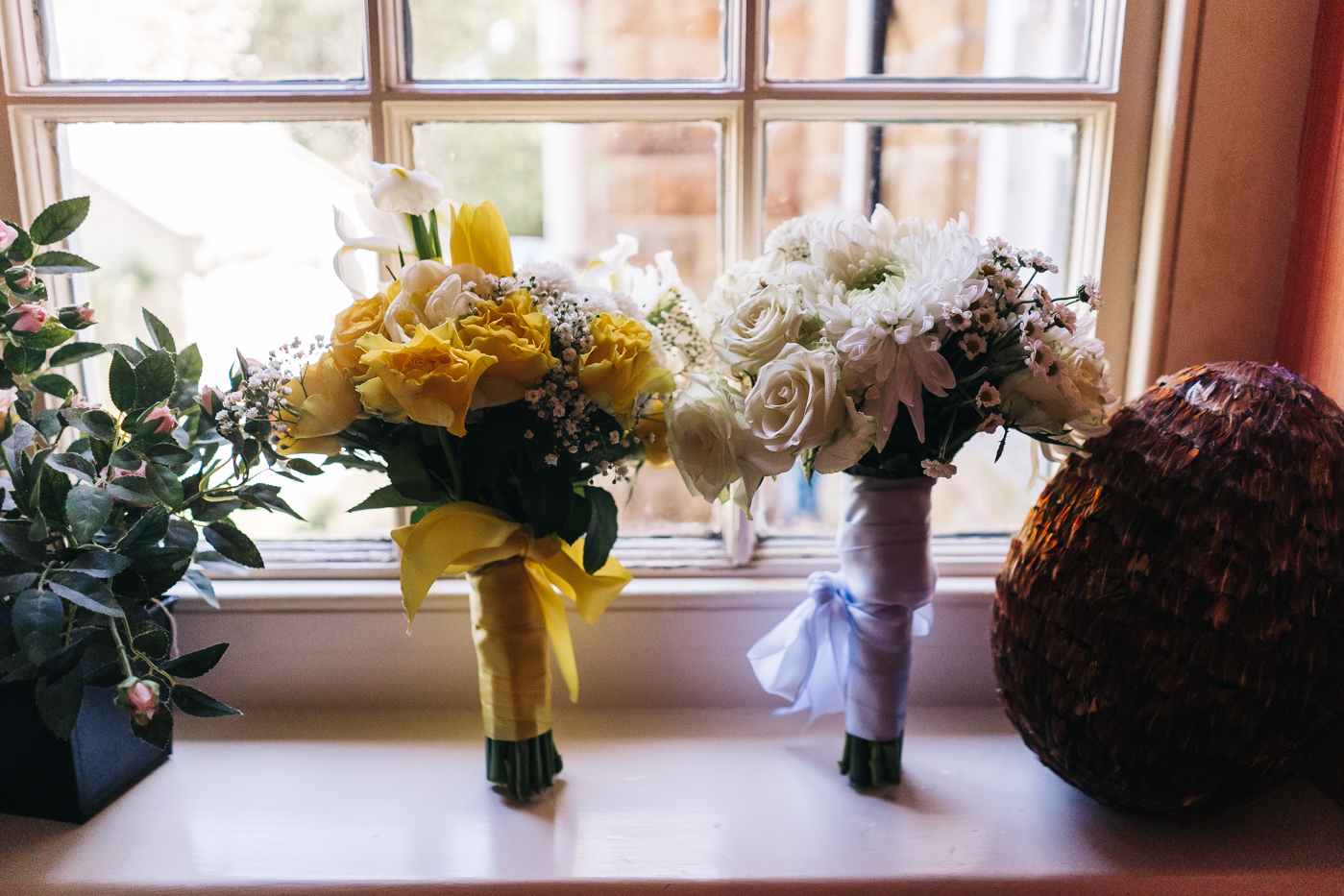 yellow and white bouquets on a windowsil. wedding at laskill house north yorkshire helmsley wedding photographer north east teesside