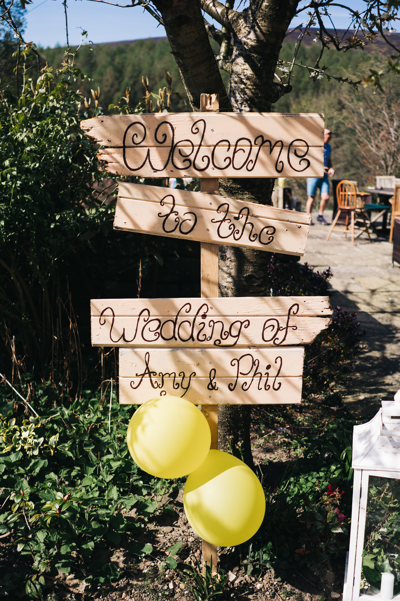 a wooden painted sign saying 'phil and amy's wedding'. wedding at laskill house north yorkshire helmsley wedding photographer north east teesside