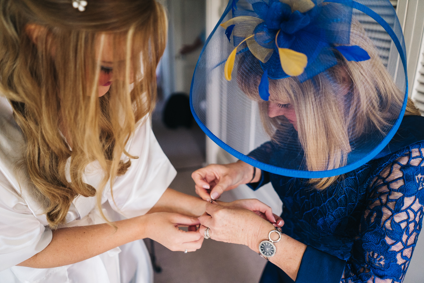 the bride's mum attached a bracelet to her wrist. wedding at laskill house north yorkshire helmsley wedding photographer north east teesside
