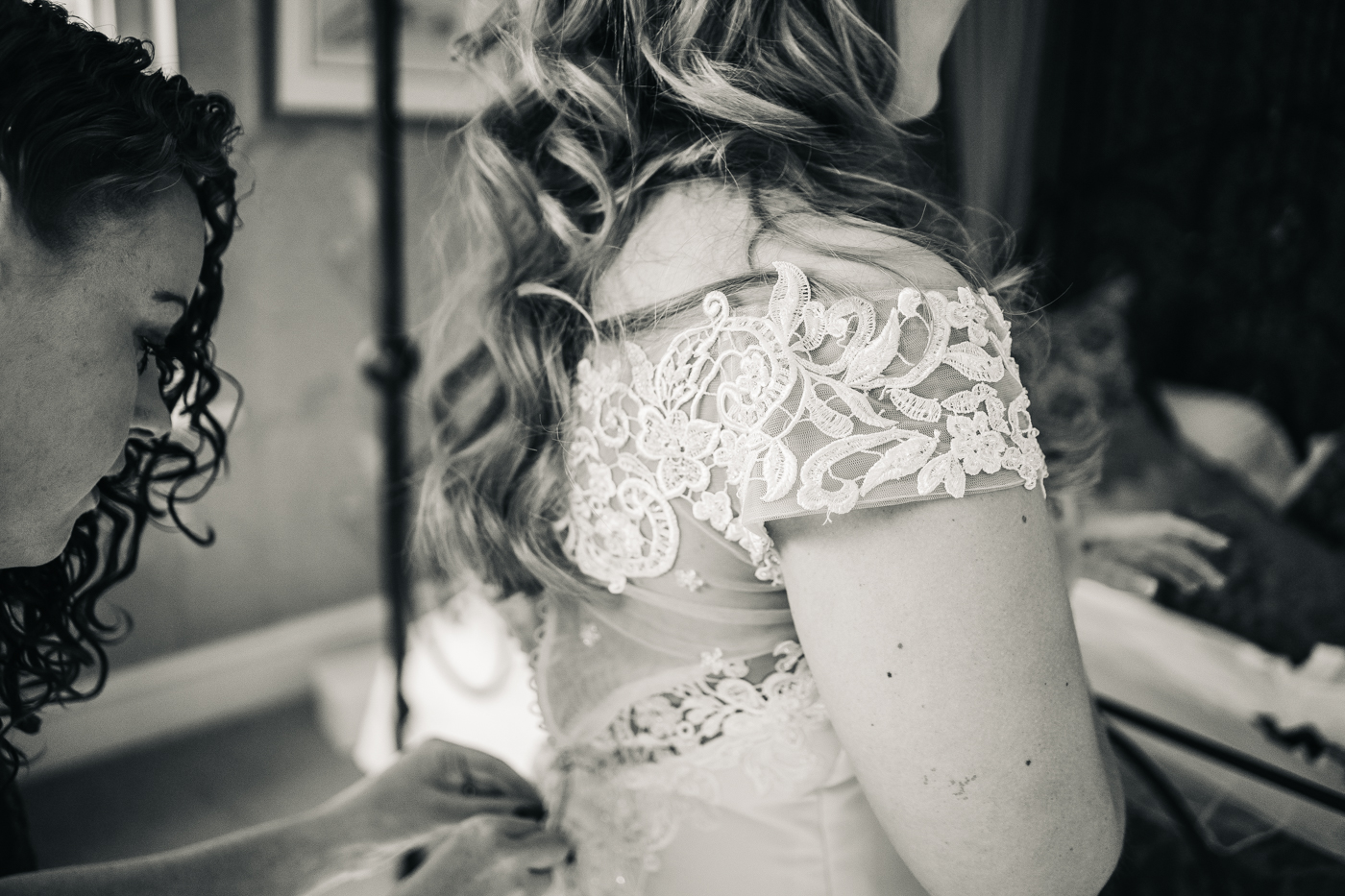 a black and white close up shot of the bride's lace dress. wedding at laskill house north yorkshire helmsley wedding photographer north east teesside