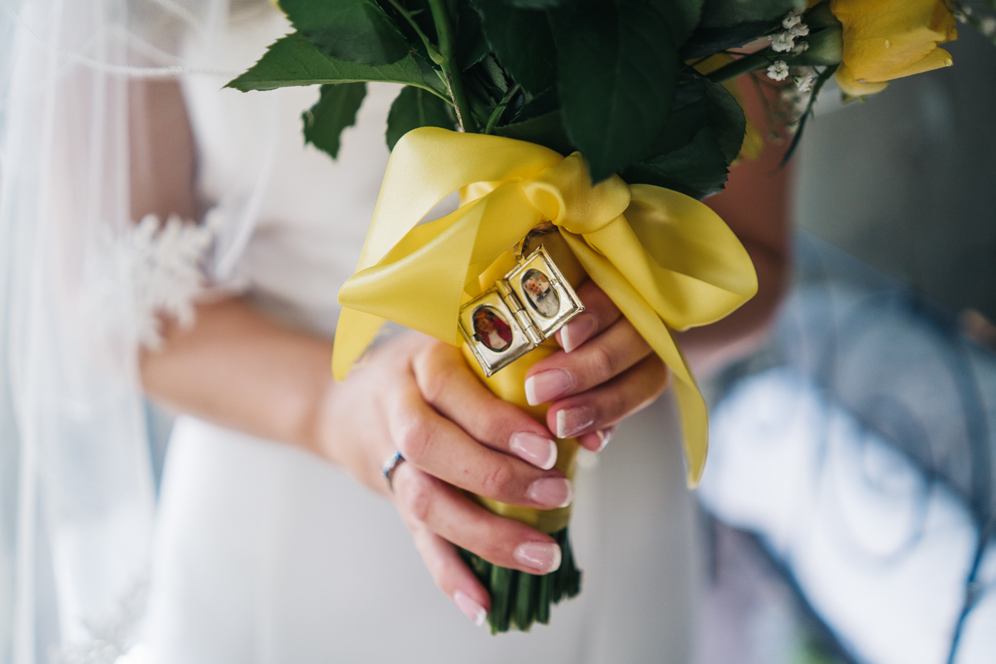 a close up shot of a locket on the wedding bouquet. wedding at laskill house north yorkshire helmsley wedding photographer north east teesside