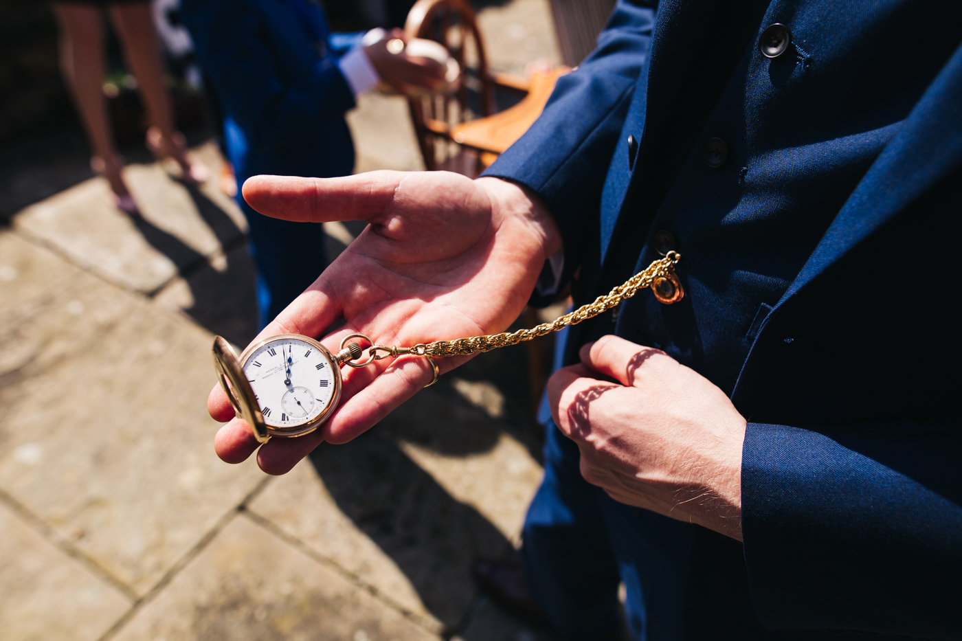 a close shot of the groom holding his dad's pocket watch. wedding at laskill house north yorkshire helmsley wedding photographer north east teesside