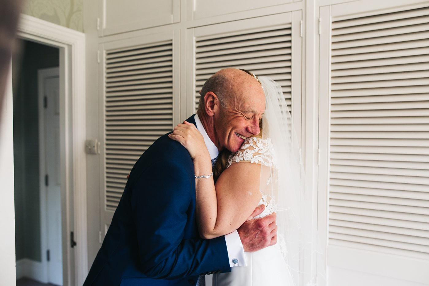 the bride and her dad hug. wedding at laskill house north yorkshire helmsley wedding photographer north east teesside